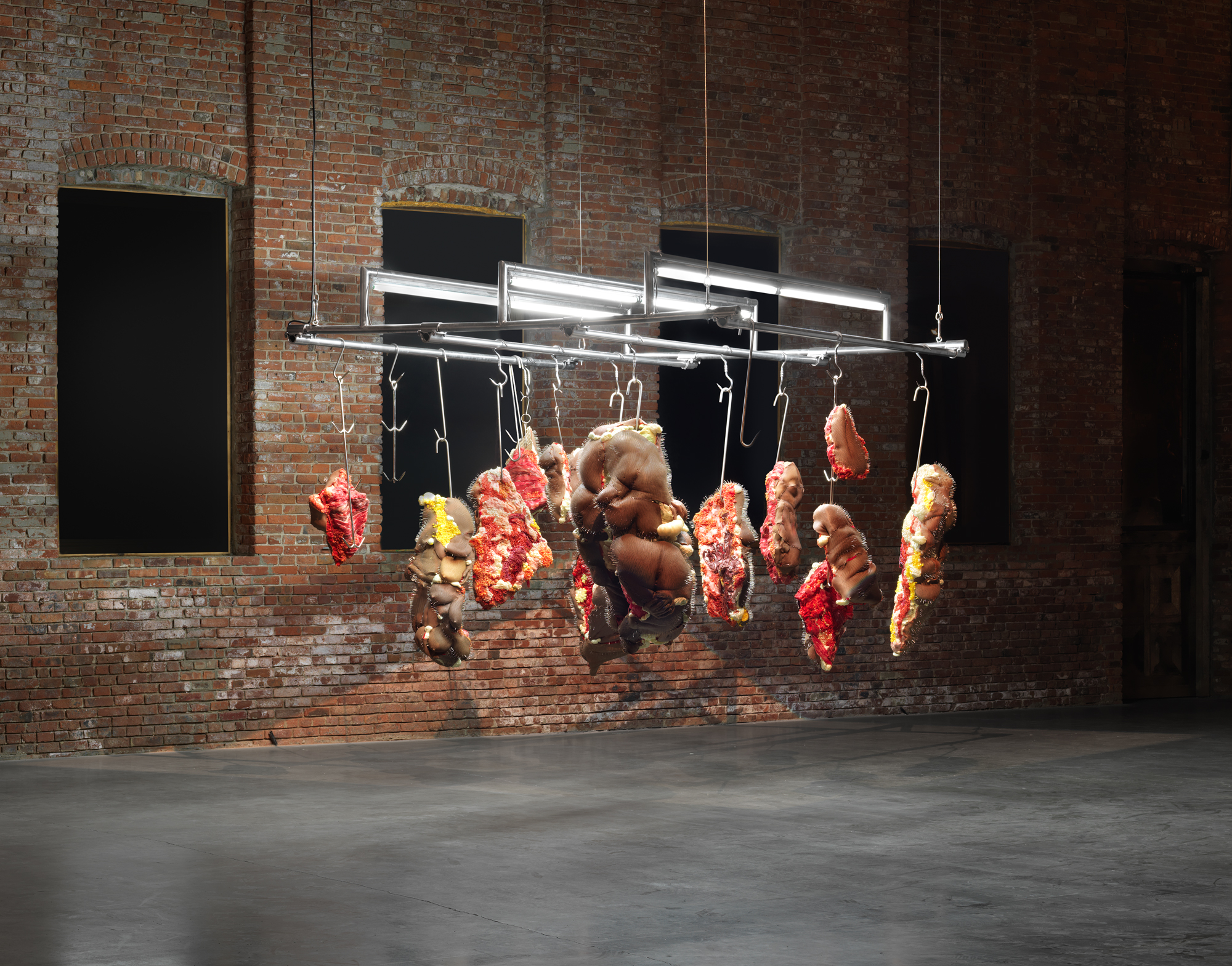 Doreen Garner Rack of those Ravaged and Unconsenting, 2017 Silicone, insulation foam, glass beads, fiberglass insulation, steel meat hooks, steel pins, pearls, 96 x 96 x 96 inches