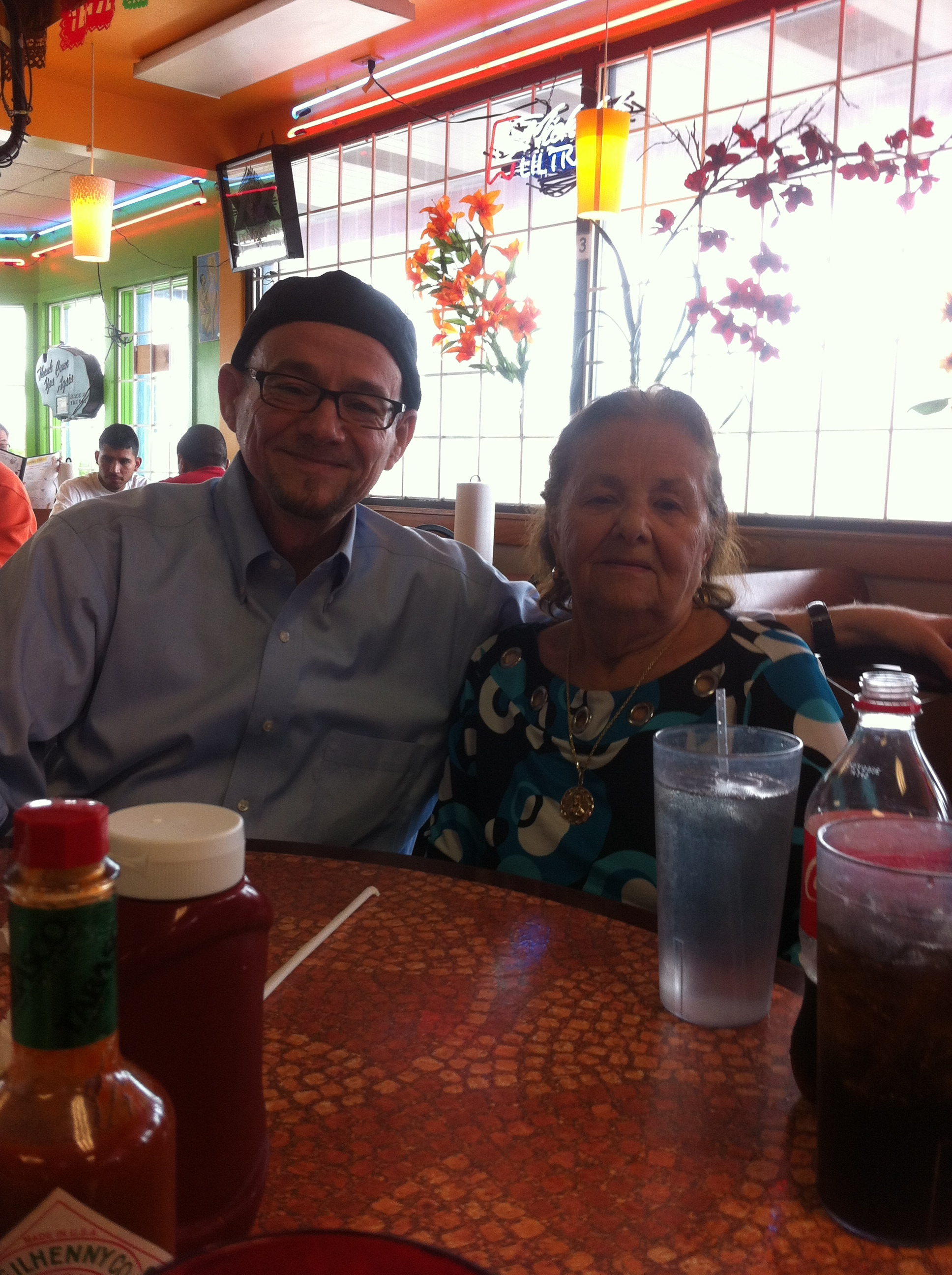 The author celebrating his mother's birthday at a Houston taqueria.