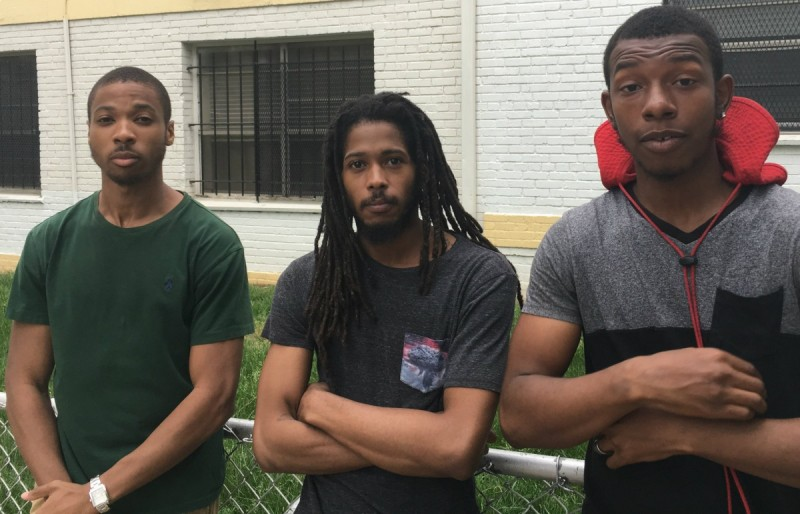 Ahrown Jones, his older brother Christopher Jones, and Marcus Robinson (left to right) visit friends and family at Brookland Manor. All three grew up in the complex; Christopher has since served in the Navy and started a local non-profit agency. All three had stories about seemingly arbitrary rules and aggressive conduct by the complex's former security employees. Image by the author, Pete Rodrigue.