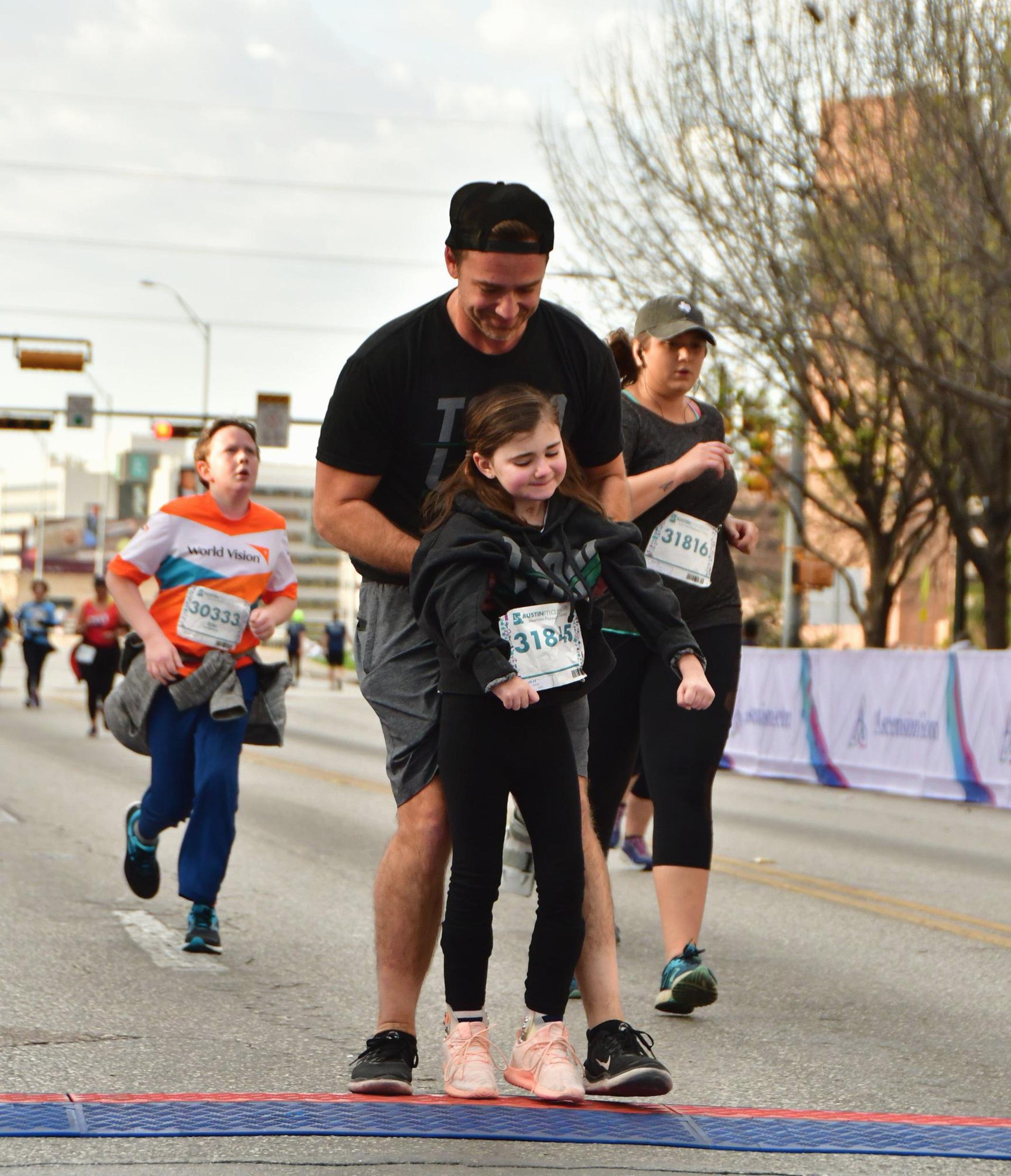 Charley and Barney Sinclair finishing 2019 Austin Marathon 5K