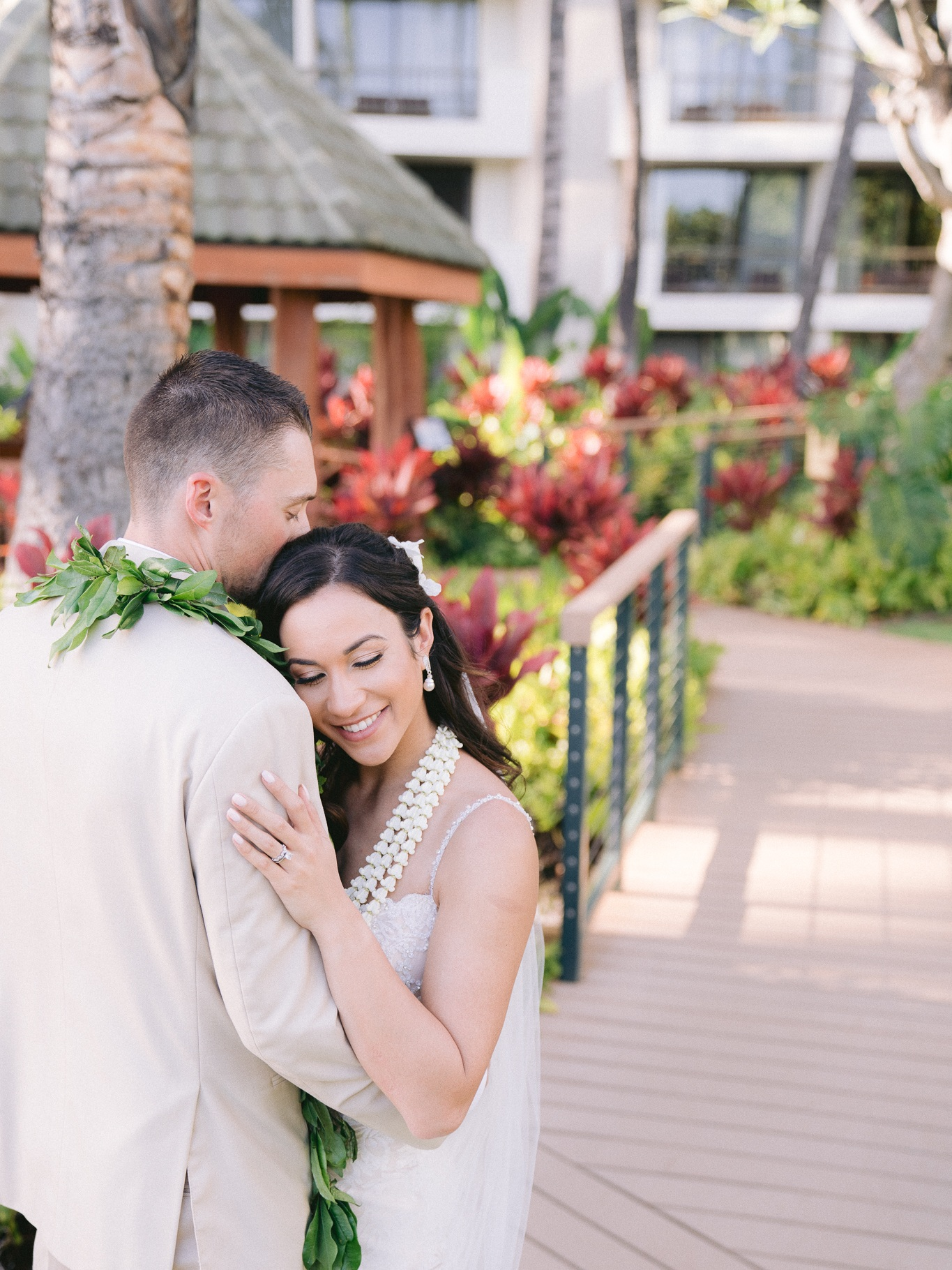 fine art wedding portrait of just married husband and wife embracing at hyatt regecncy maui destination wedding in lahaina hawaii taken by bay area wedding photographer, vivo photography.