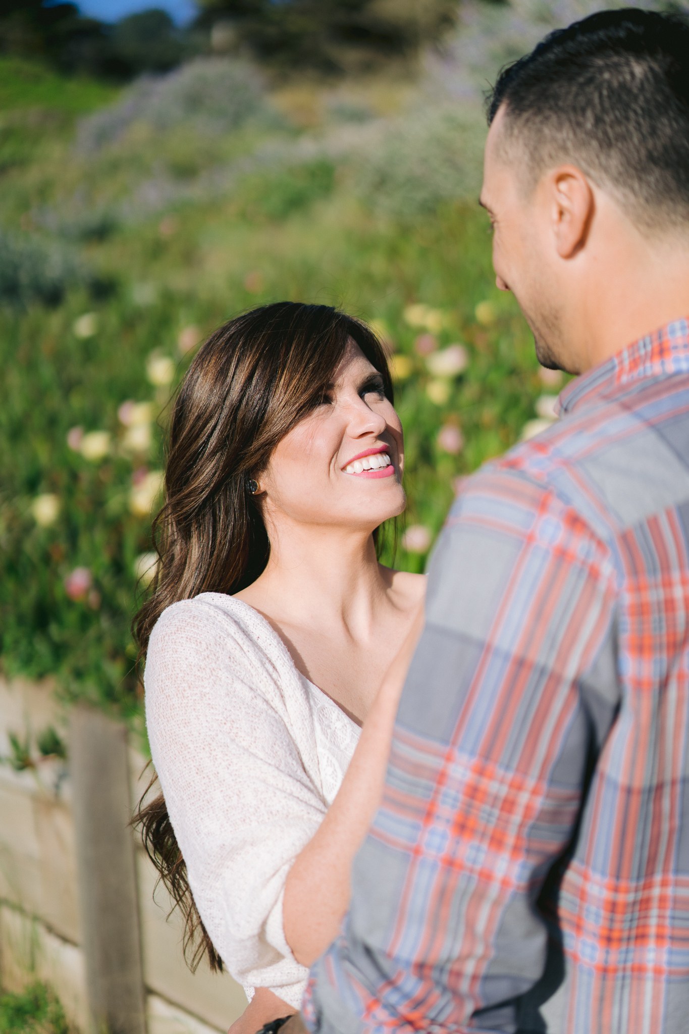 Close up of woman looking into the eyes of her fiance at San Francisco engagement photo shoot.