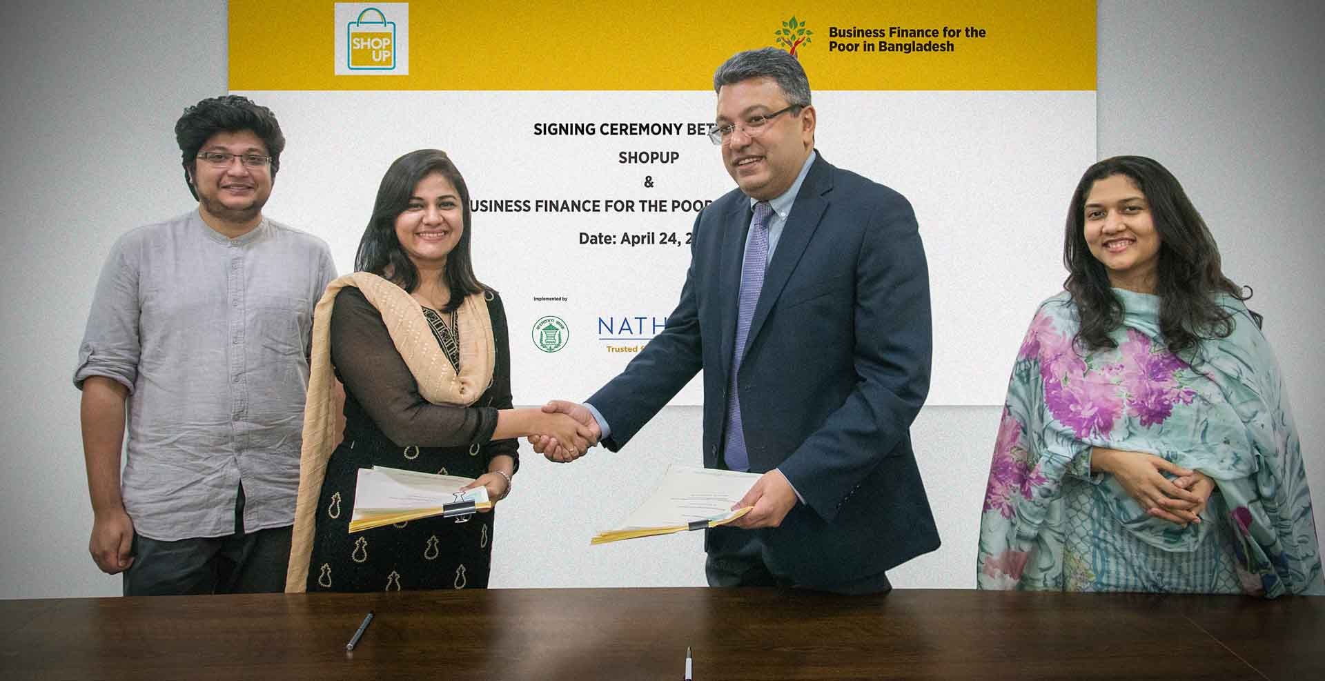 ShopUp and Business Finance for the Poor in Bangladesh representatives (Project Director Buddhika Samarasinghe and Challenge Fund Coordinator Shamira Mostafa) at a Challenge Fund signing ceremony in April 2018.