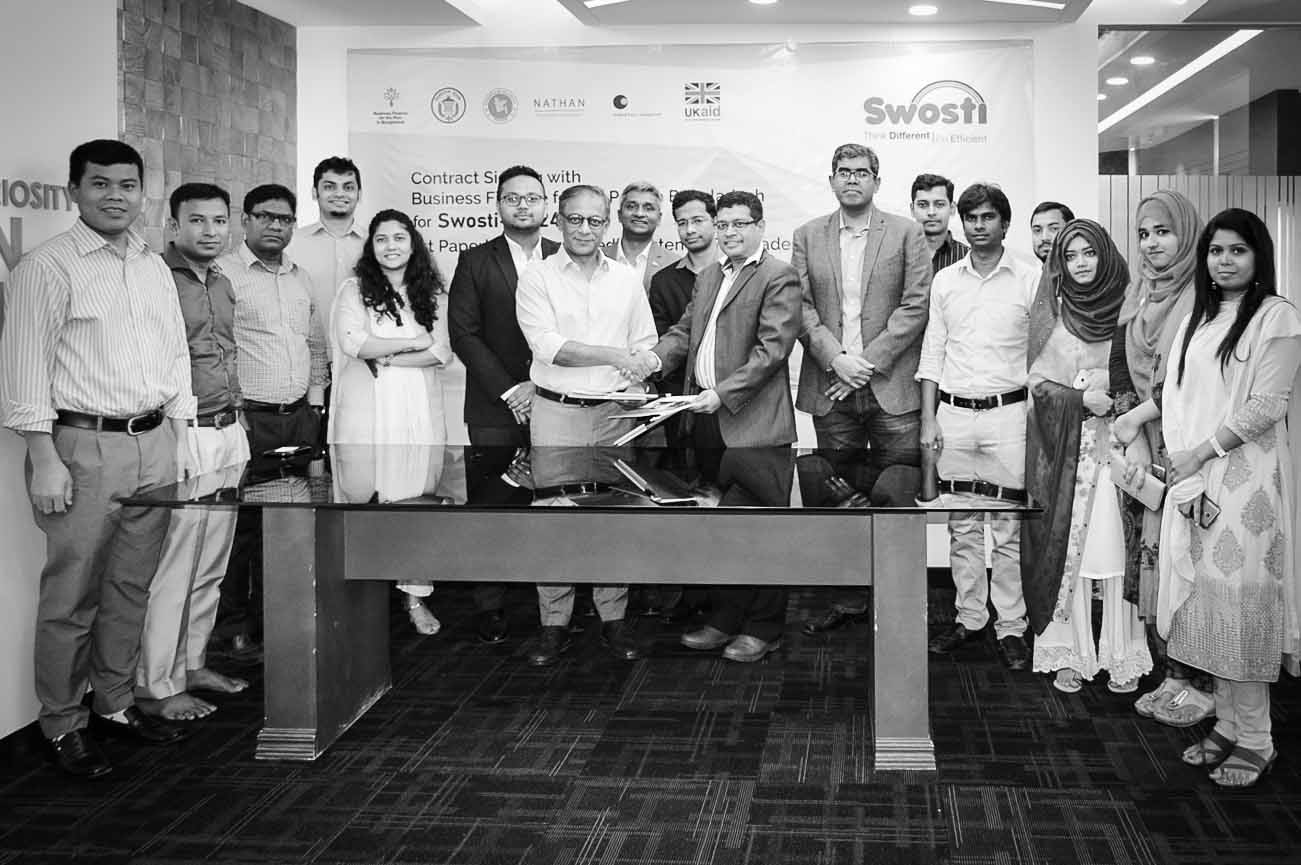 Swosti and Business Finance for the Poor in Bangladesh representatives for a signing ceremony together in May 2018.