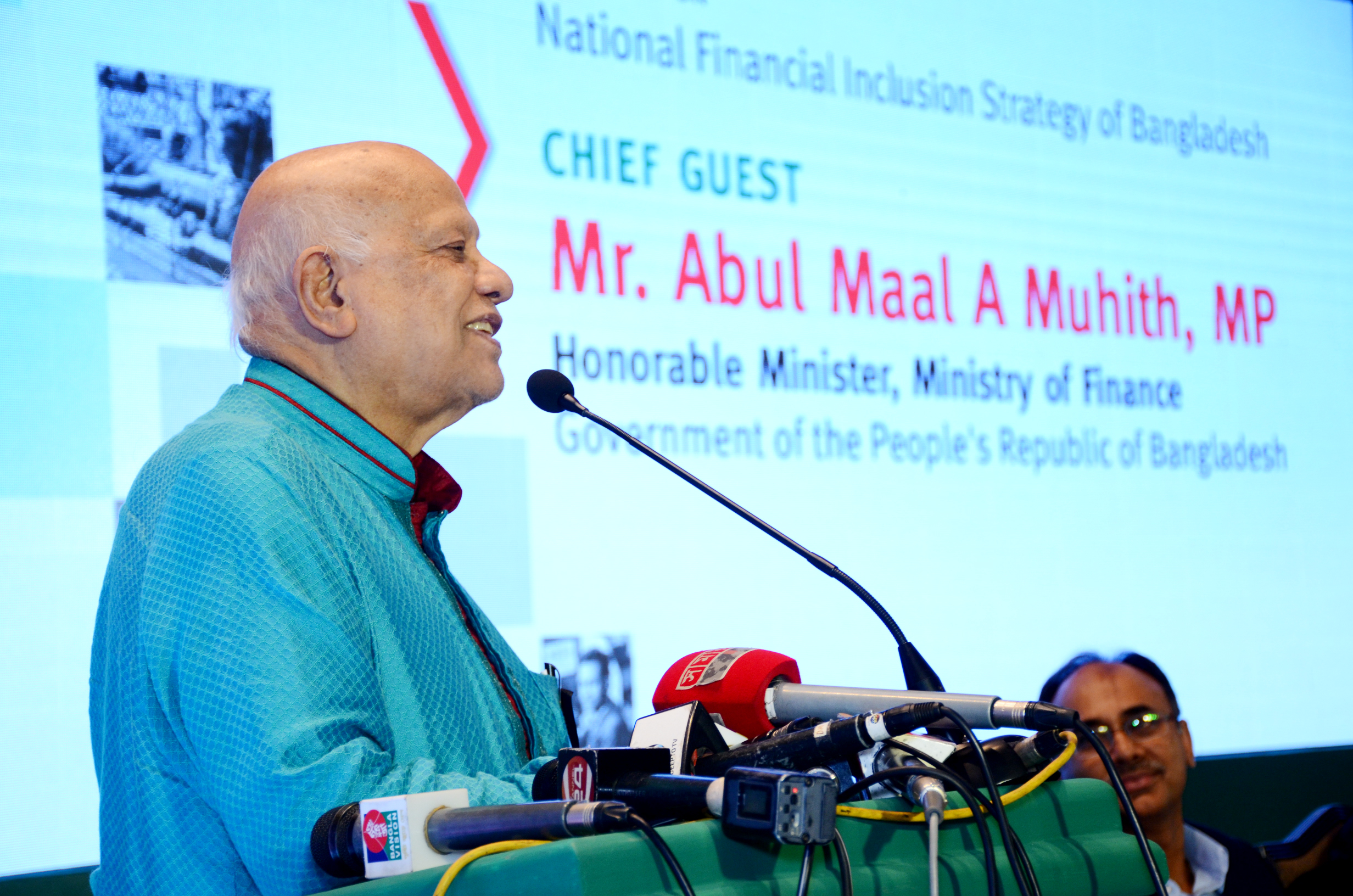 """Mr. A.M.A Muhith, Honorable Minister, Ministry of Finance, Government of Bangladesh speaking during the event. In his speech, Mr. Muhith stated """"There are less than 101,000 banking institutions in a country of 160 million people, which is not enough."""""""