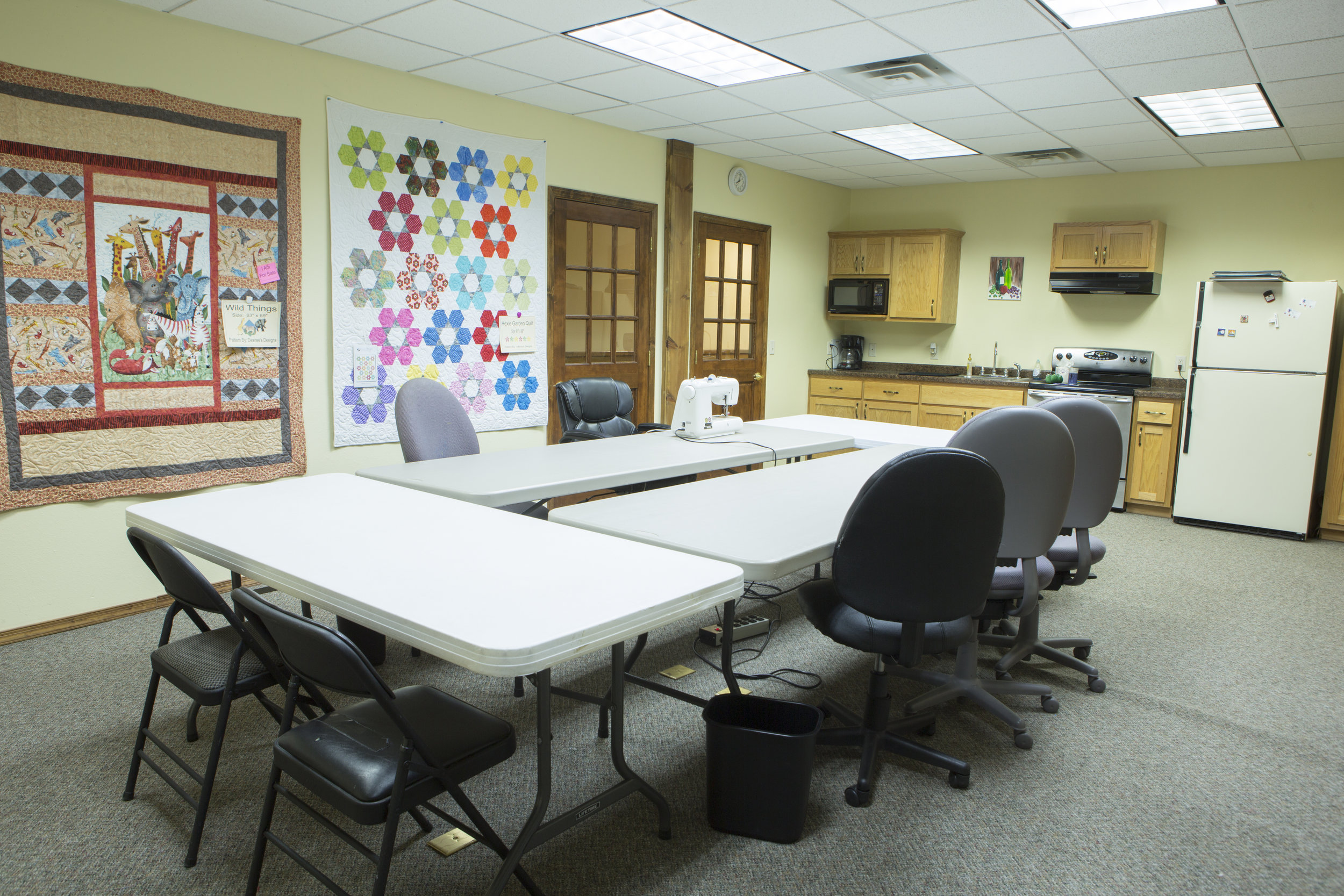 Work Room - Includes: 2 irons and ironing boards, cutting table and mat, and space for 8 people.