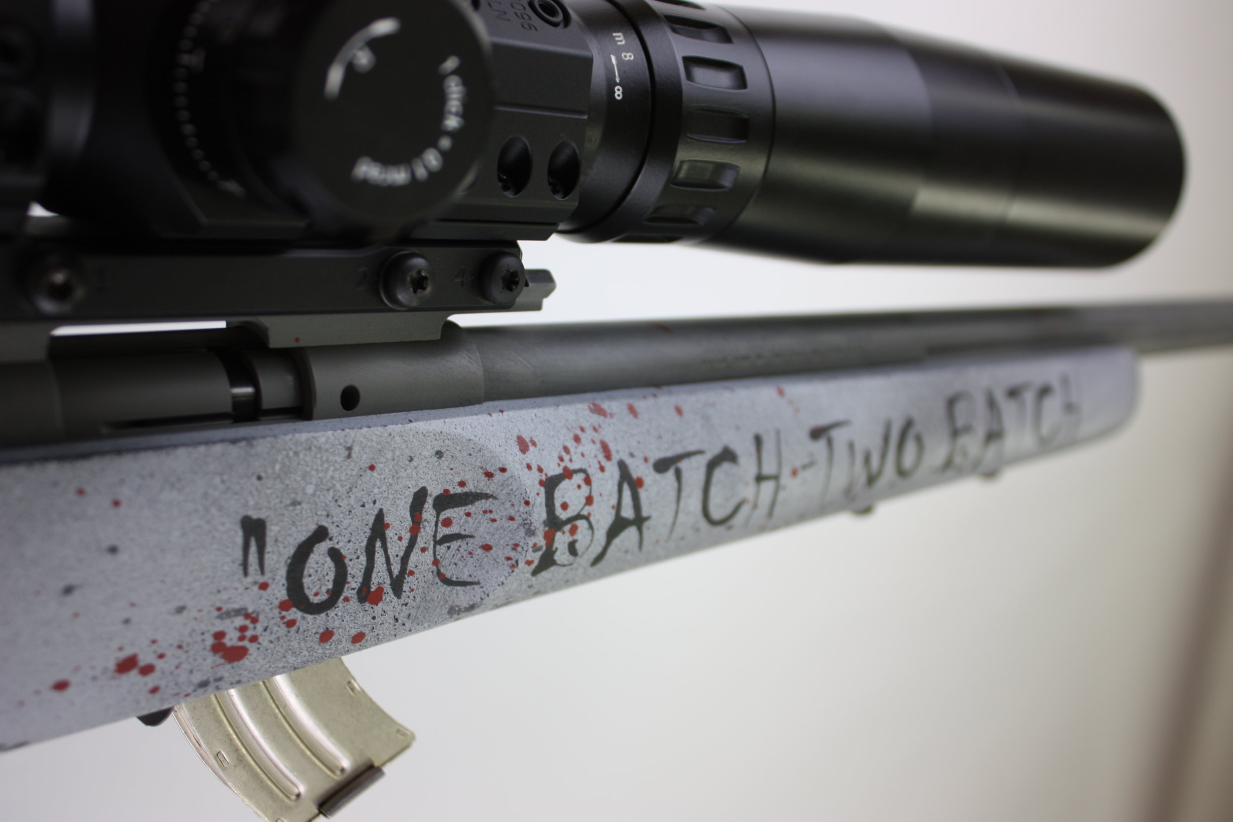 The quote on the rifle is a small touch from the Netflix original Series of The Punisher.