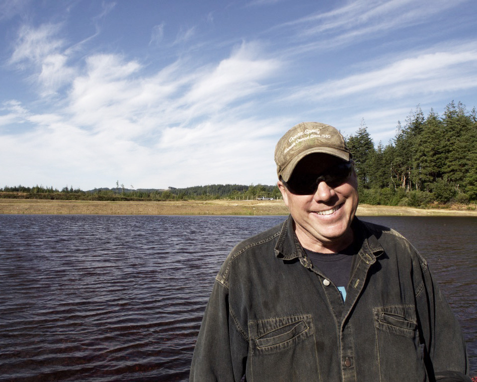 Owner David Haueter stands near his flooded bog during the short harvest season in late-September.