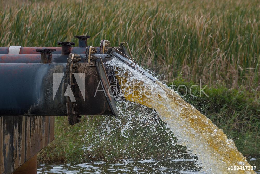 Wastewaterflowingoutofalargepipe.jpg