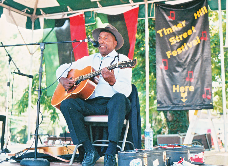 American Piedmont bluesman John Jackson plays at the Tinner Hill Street Festival, which was renamed the Tinner Hill Blues Festival, in 2000. (Photos: Ed Henderson)