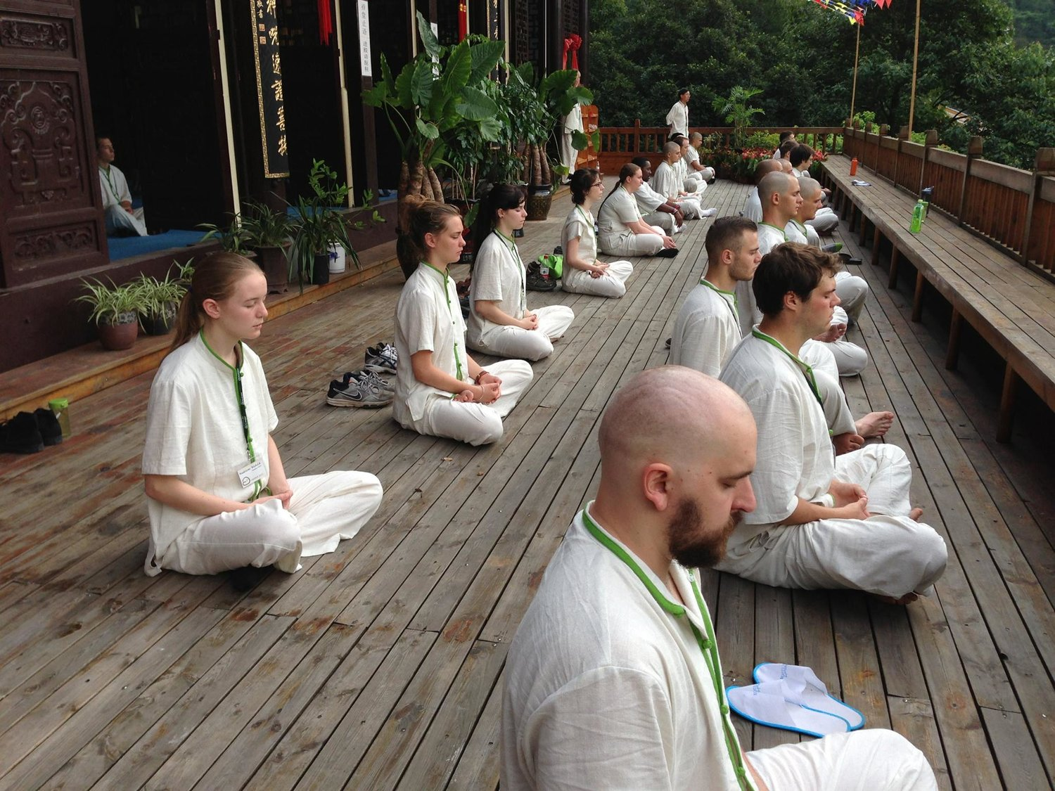 Morning Mediation in Chan Buddhist temple in Wenzhou China. Cory's bald head can be seen front right.