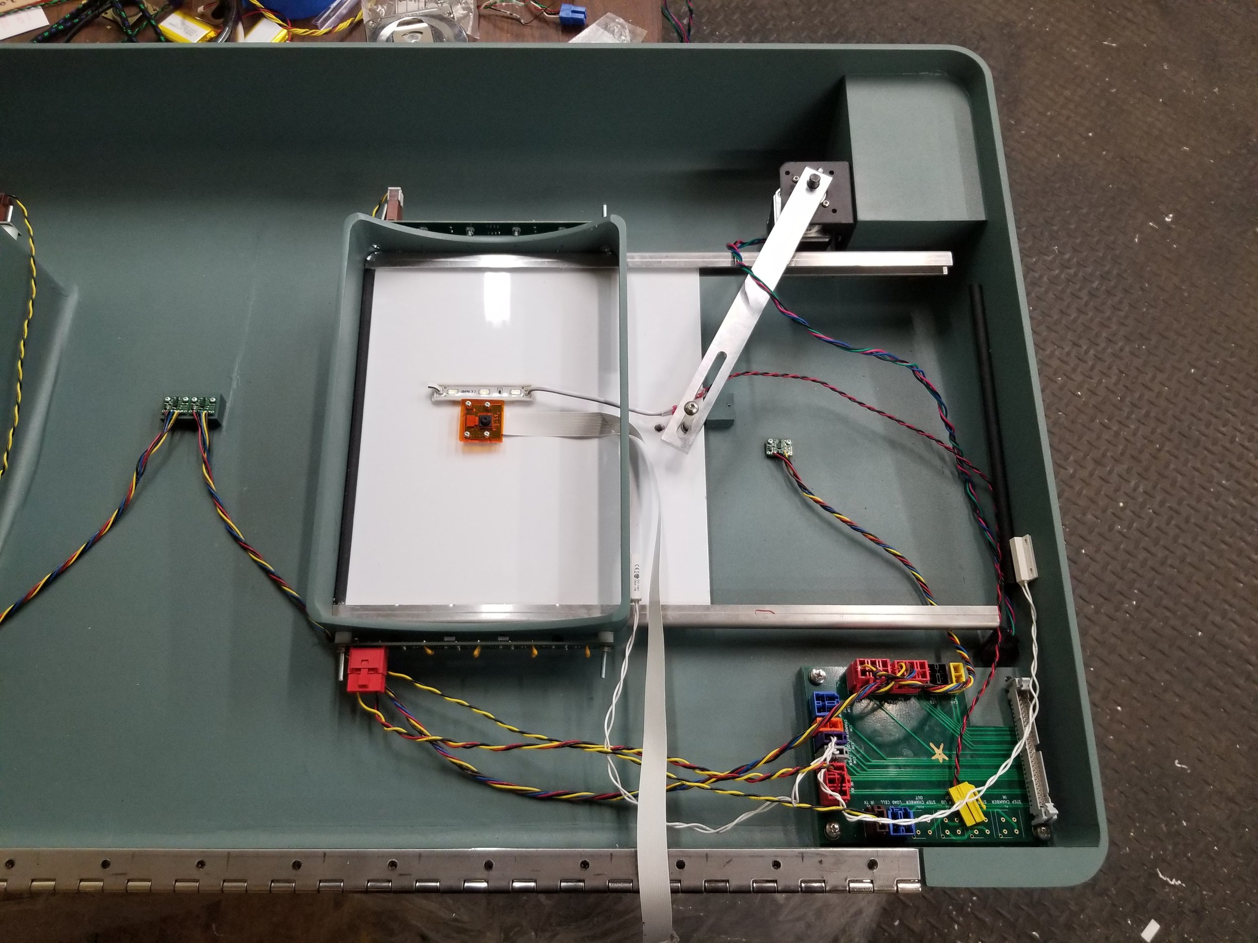 Functionality - Item disposal is detected by an array of IR transmitters. After detection, the lid is closed by a stepper motor driven pin-slot mechanism. The item is weighed by a 'tray' beneath the actuating chamber while the item is illuminated and photographed The item is identified as either landfill waste or recycling and disposed of by a stepper motor and worm gearbox driven actuating chamber. Time-of-flight sensors located in the top measure the fullness of the bins. Data from the unit is relayed to a dashboard in real-time, which can be accessed by customers visually analyze data collected by the TrashBots.The electronics in the top plug into a breakout board making the top modular, easier to maintain, and quicker to assemble. The breakout board is connected by a ribbon cable to a primary PCB located on the chassis of the TrashBot.The videos below show the functionality and user flow of the product.