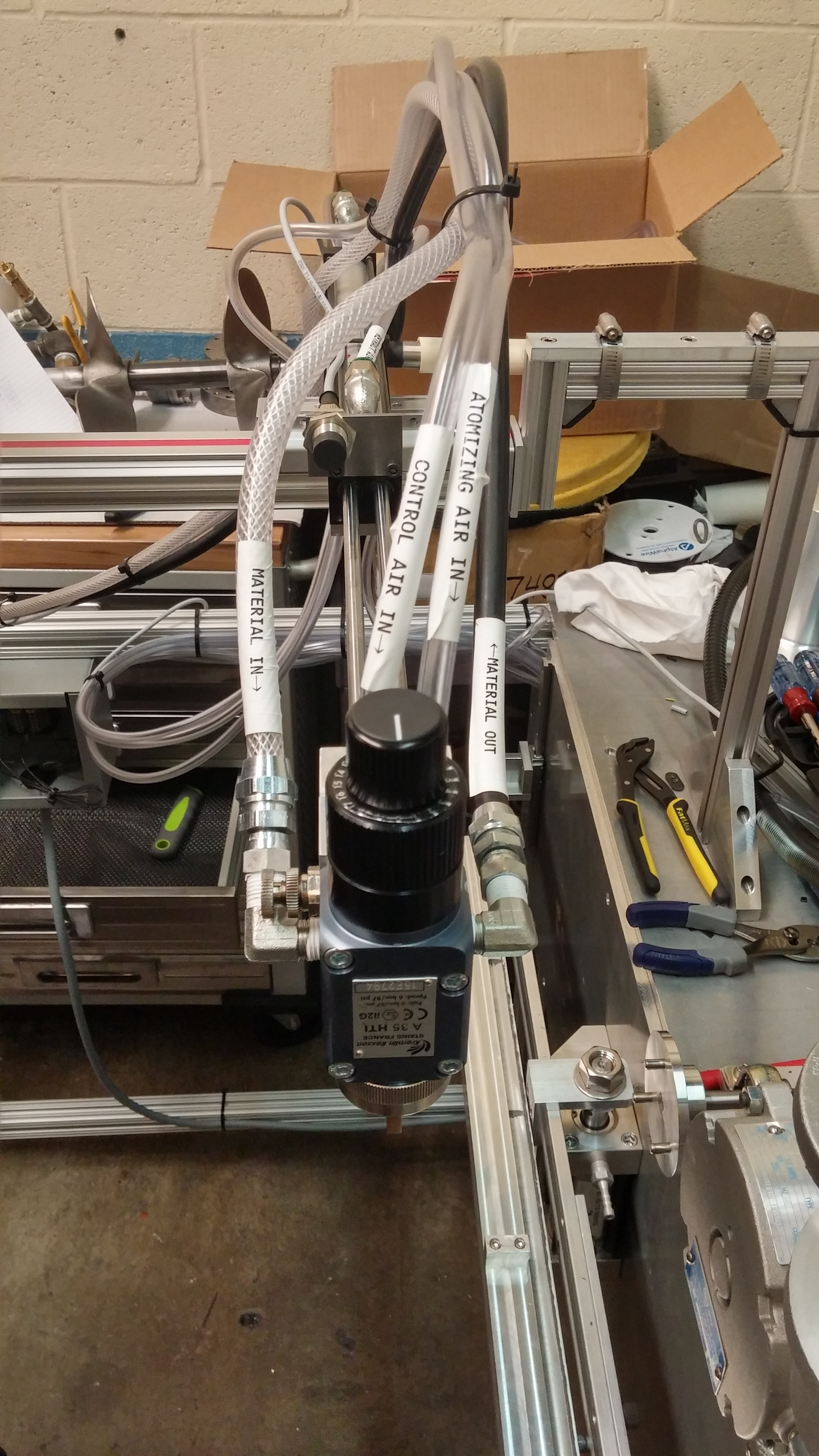 Pneumatic fluid and air lines attached to the applicator