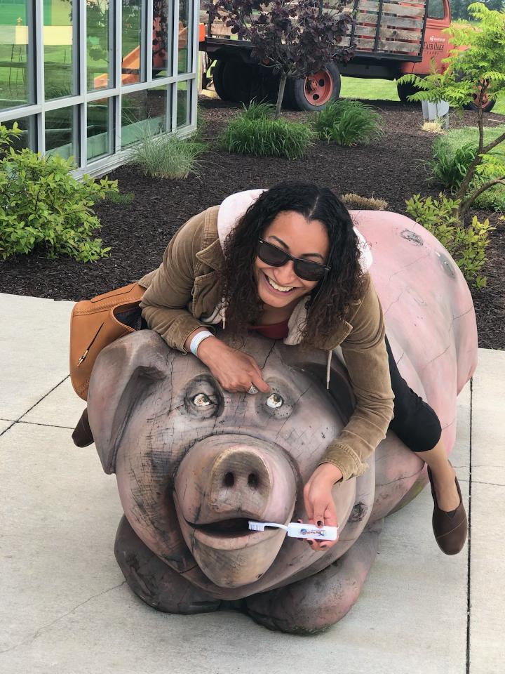 Bri brushes the pigs teeth at Fair Oaks Farm in Indiana