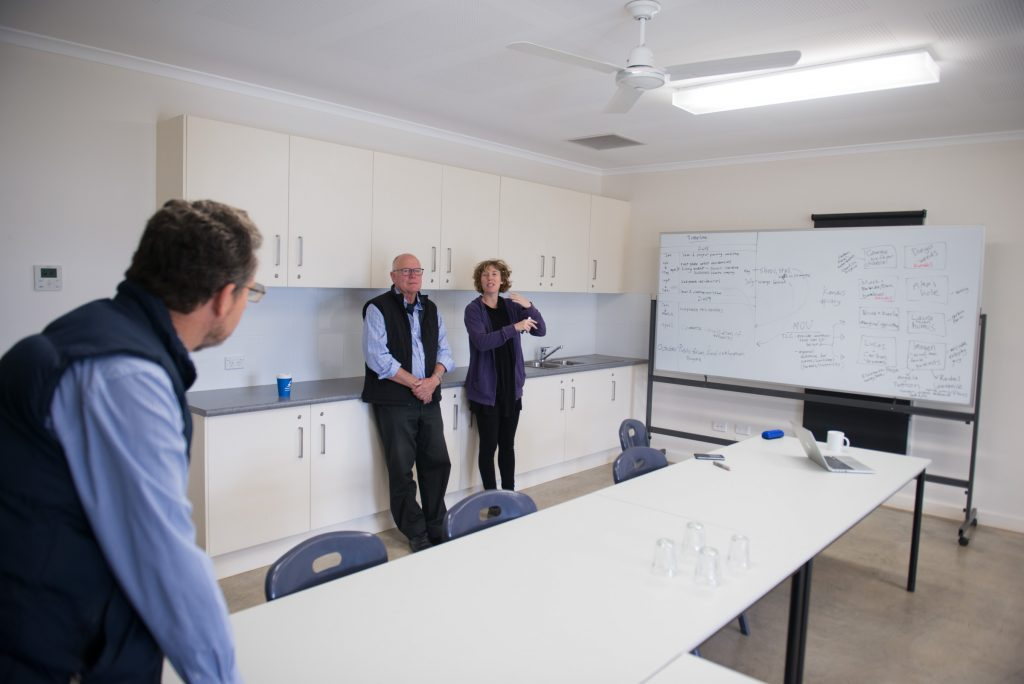 Rick Hutton, Garry McDougal and Laura Fisher at the dreaded white board. photo Alex Wisser