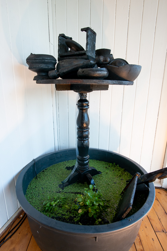 Georgina Pollard's Confinement explores the symbolic and material properties of biochar through a living fountain