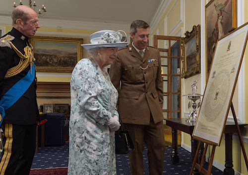 What an honour: Her Majesty the Queen admires a Roll of Honour
