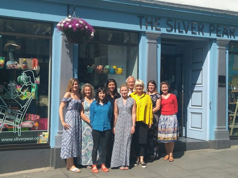 Janet with her dream team outside the shop