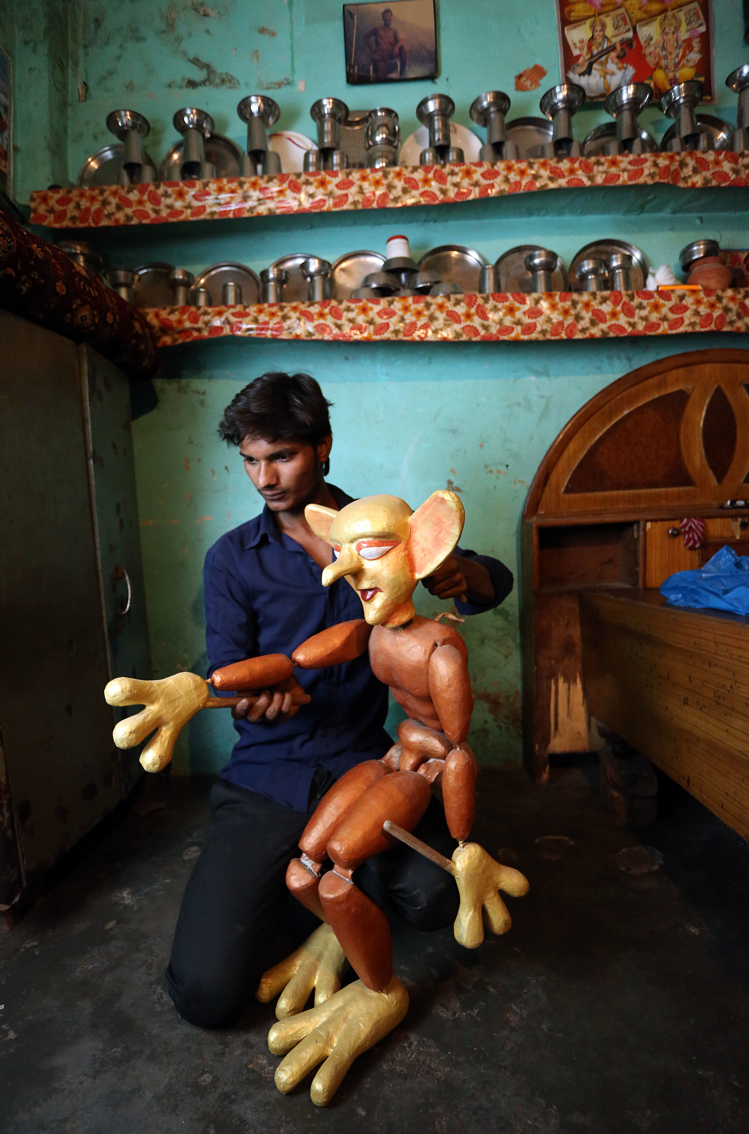 Puppeteer Sarju Bhaat practises using his puppets at his home in the Kathputli slum colony of New Delhi, India, December 7th, 2014. He is one of 40,000 people living in the slum, which is popularly known for being the worlds largest colony of street performers, including magicians, snake charmers, acrobats, singers, dancers, actors, traditional healers and musicians and puppeteers. Their livelihood is under threat however as the Delhi government has obtained contracts to demolish the colony to make way for developers to build high-rise apartments.