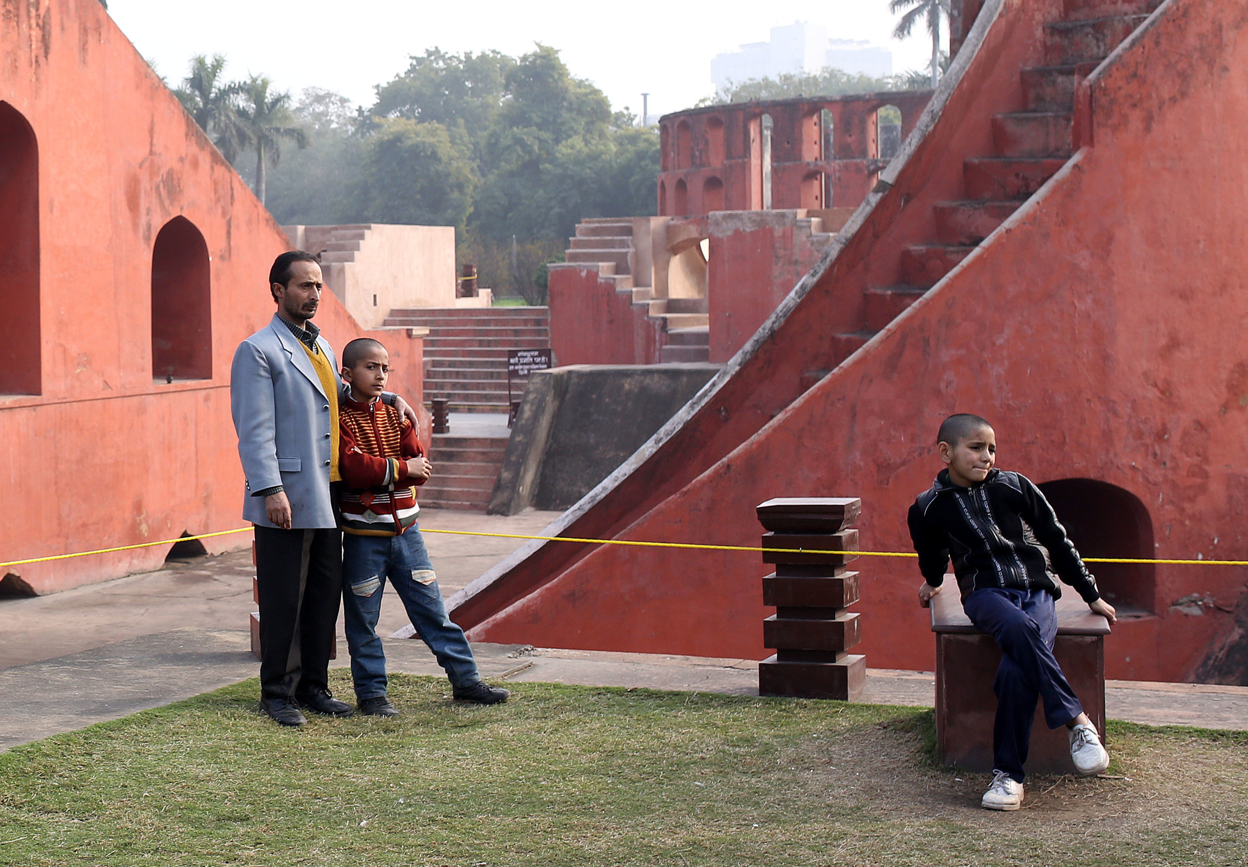 Children are pictured posing for photographs among the astronomy instruments at the Jantar Mantar in New Delhi.