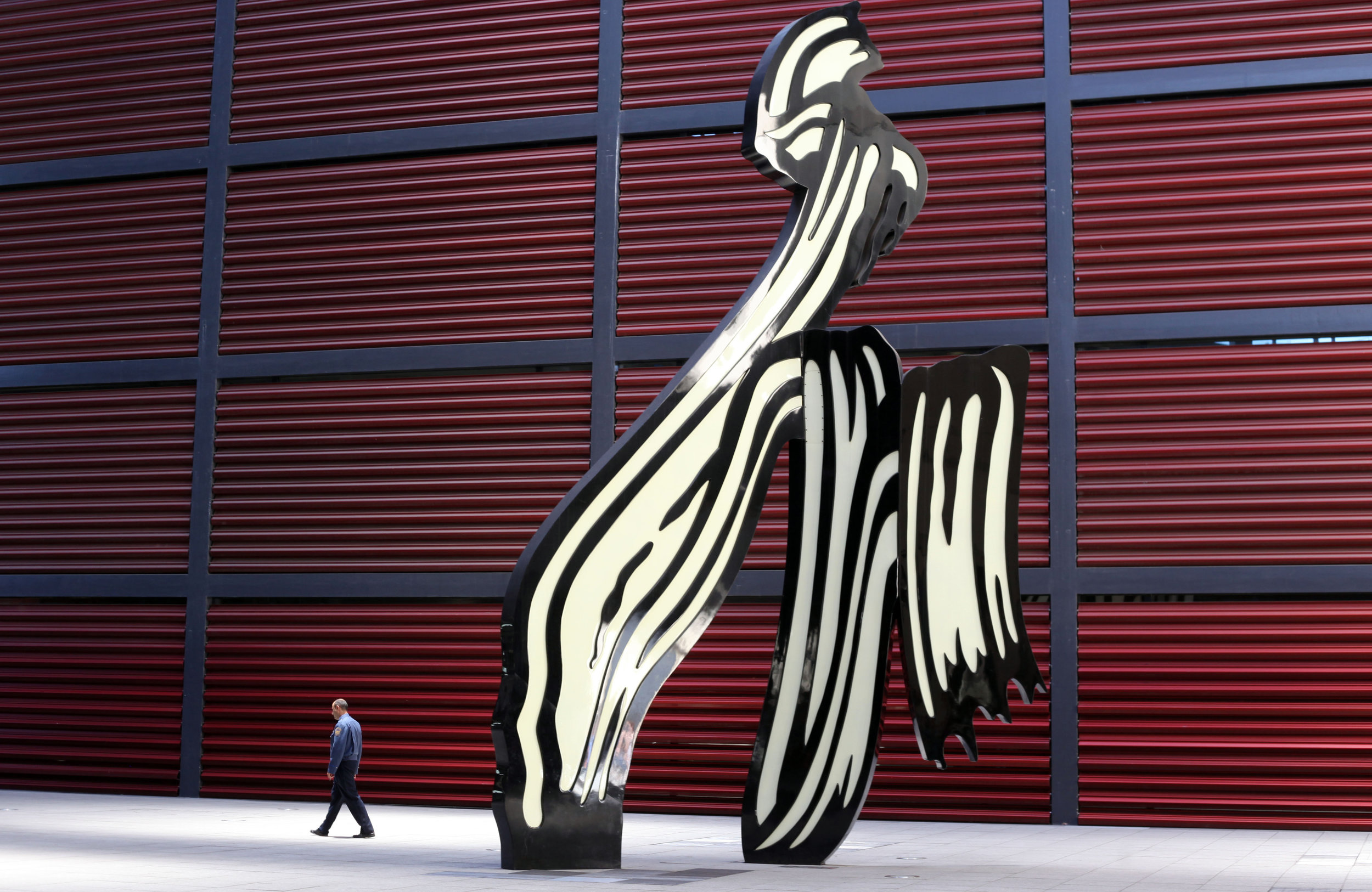 A visitor walks past a sculpture on display at the Museo Nacional Centro de Arte Reina Sof�a gallery in Madrid, Spain.