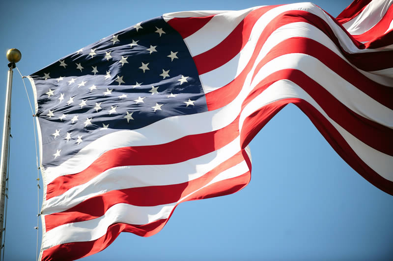 United States flag blowing in the wind.
