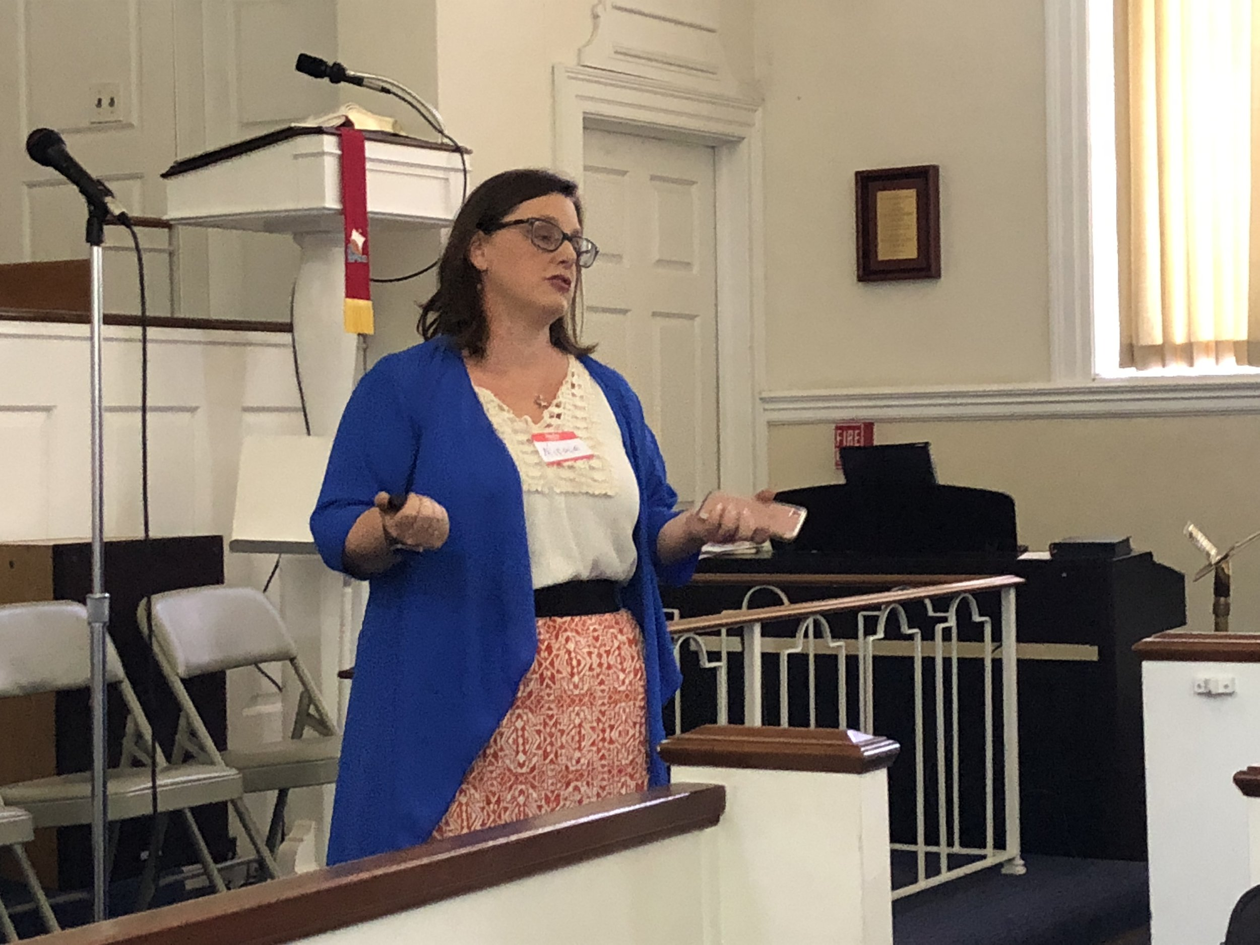 Nicole Johns from POWER speaking at the May 20th H-CAN meeting.