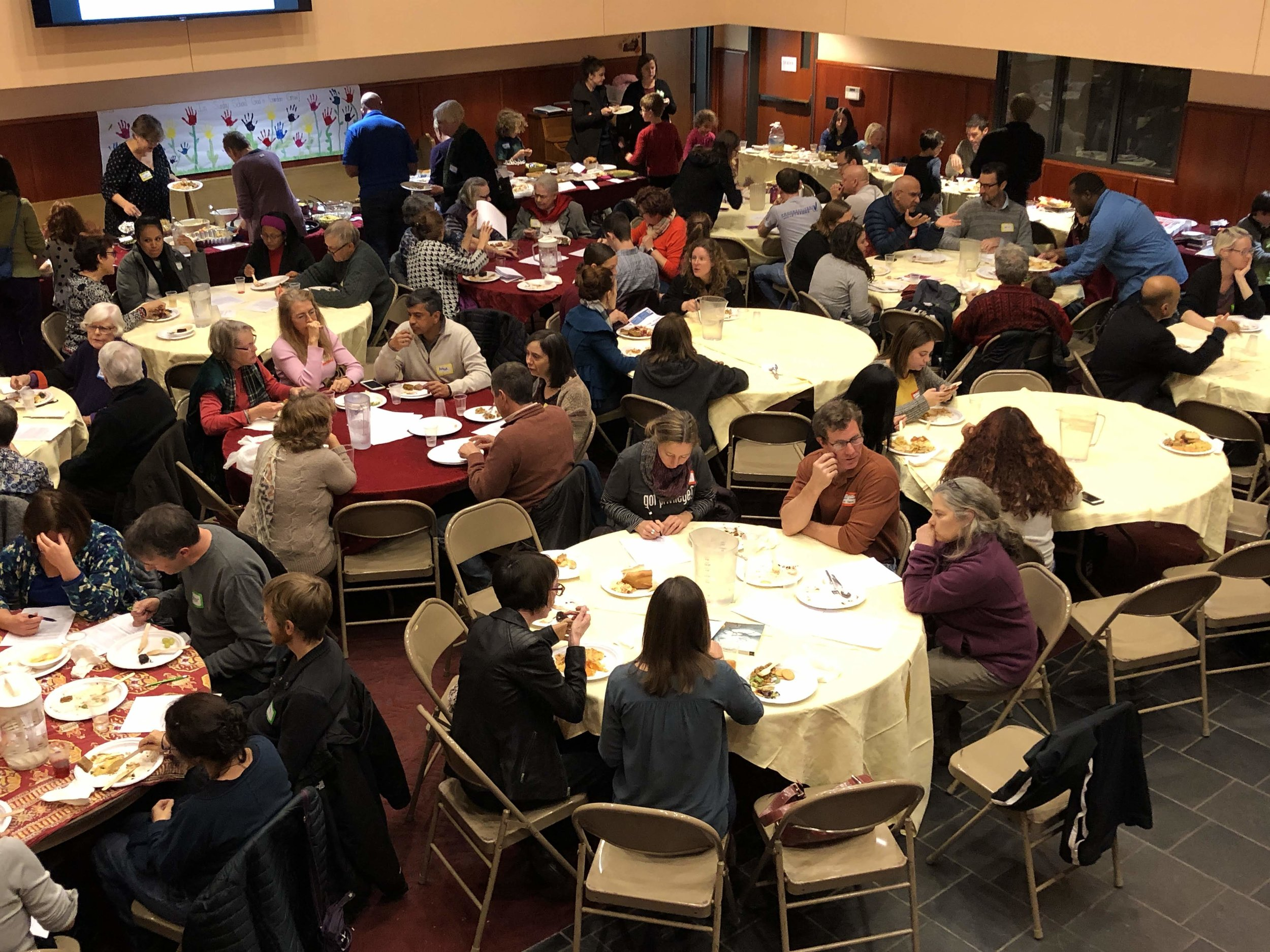 Families take part in the potluck after the talks.