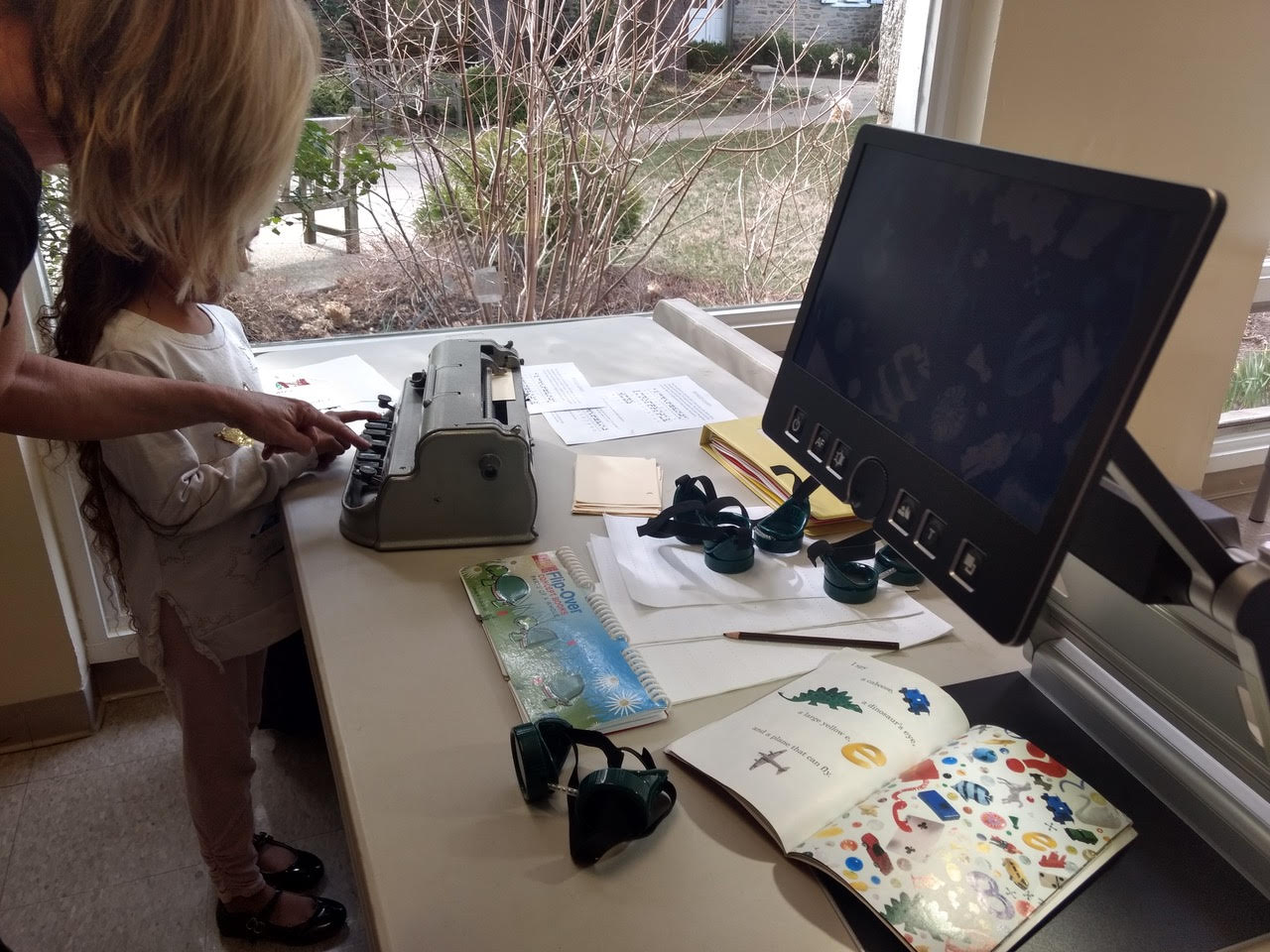 A child learning how to use adaptive accessibility technology at the How to Talk to Kids About Disability event.