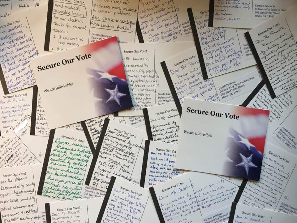 Completed postcards that will be sent to election officials.