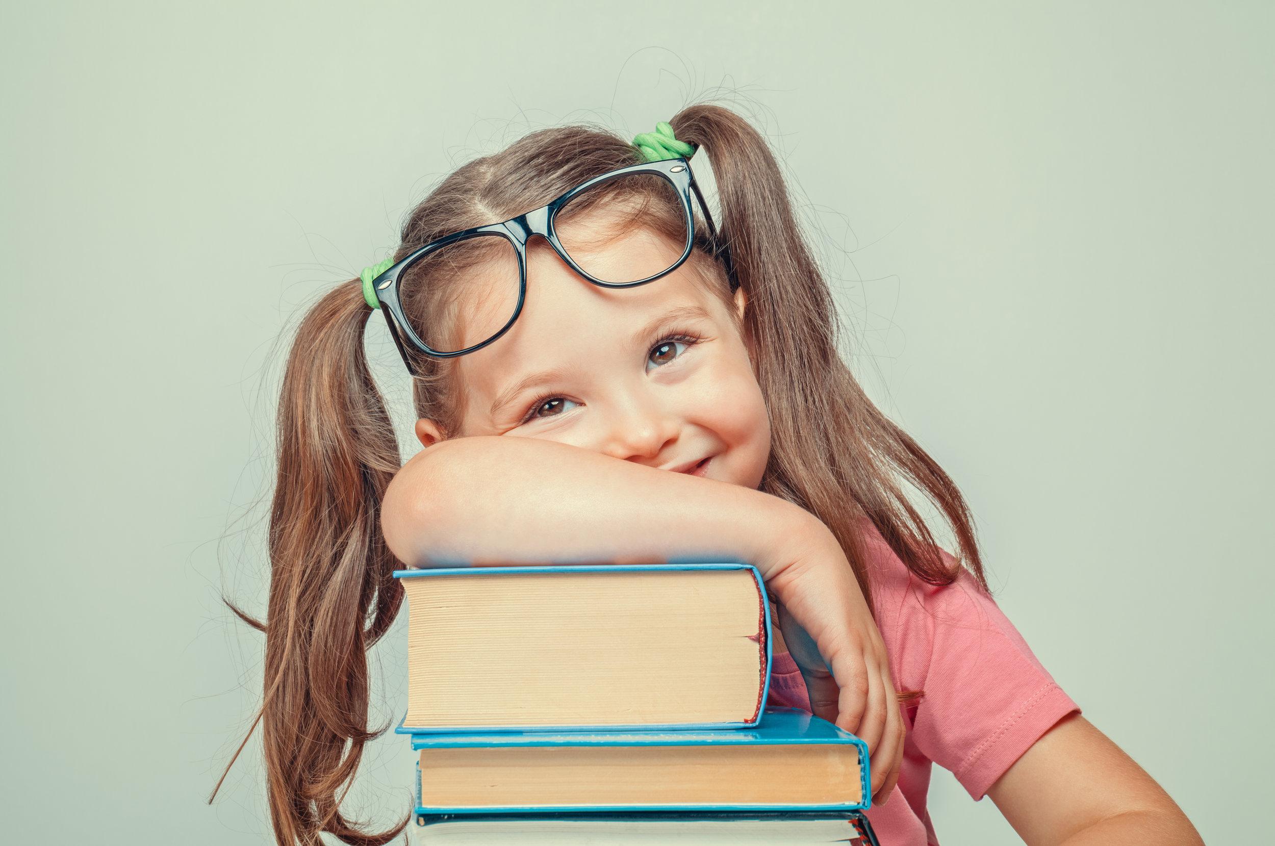 little girl books brains beauty.jpeg