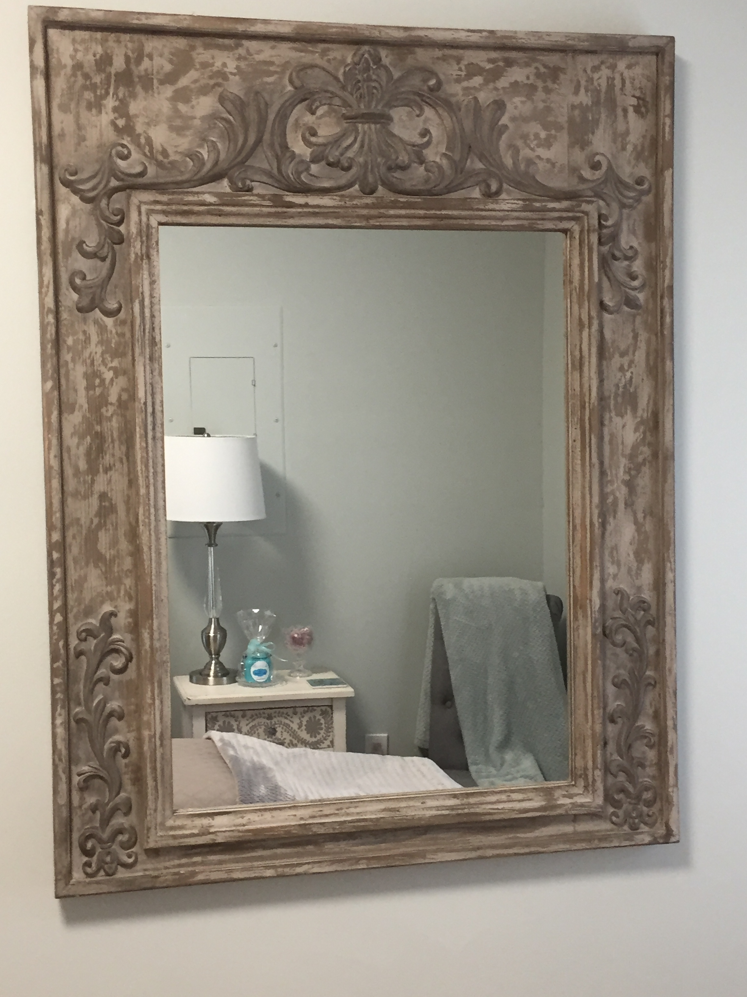 A mirror reflects a treatment room