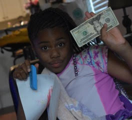 Natalia's little cousin celebrating her financial prosperity!
