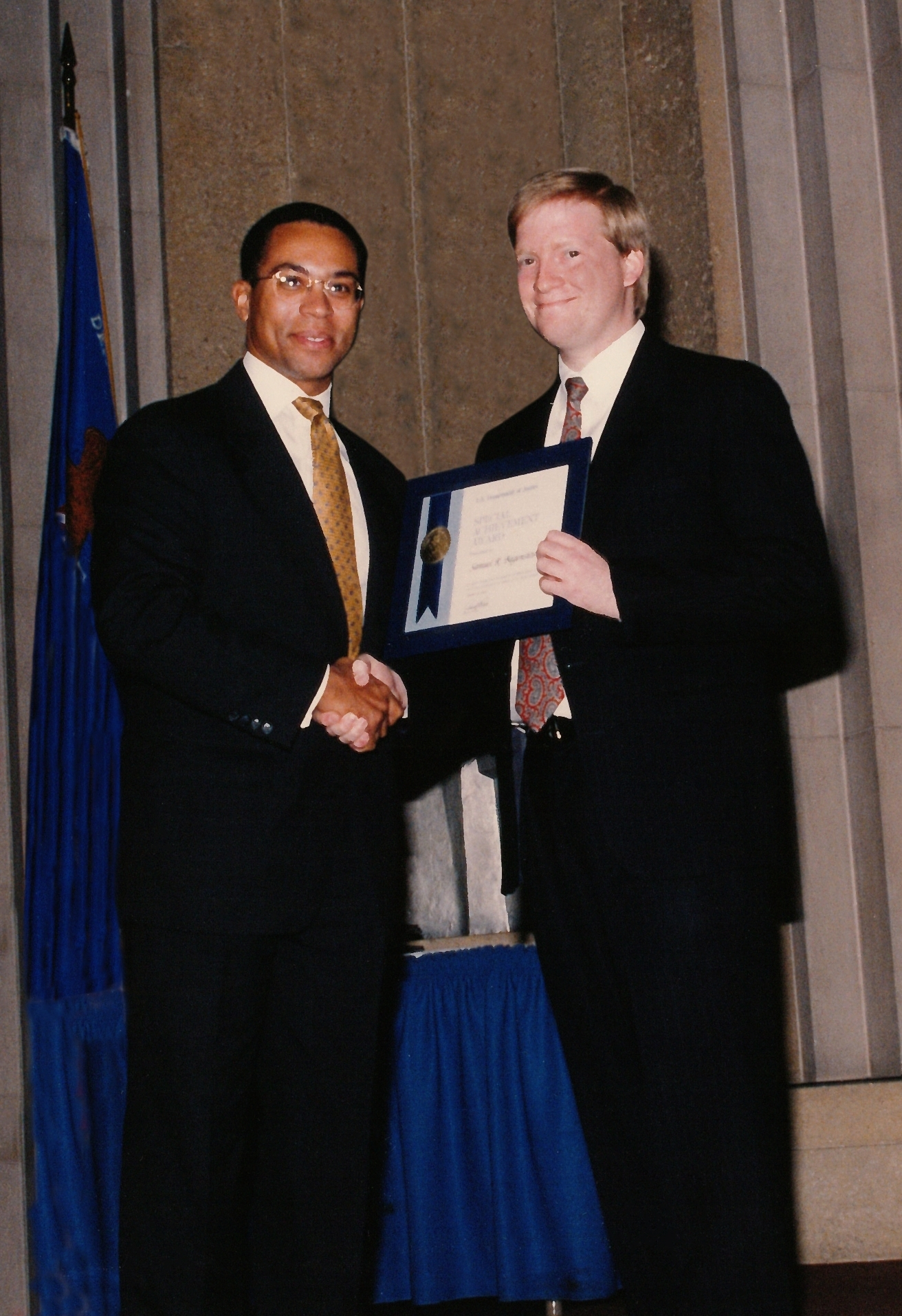 Sam receives an award from Gov. Deval Patrick, then the head of the Civil Rights Division at the U.S. Department of Justice