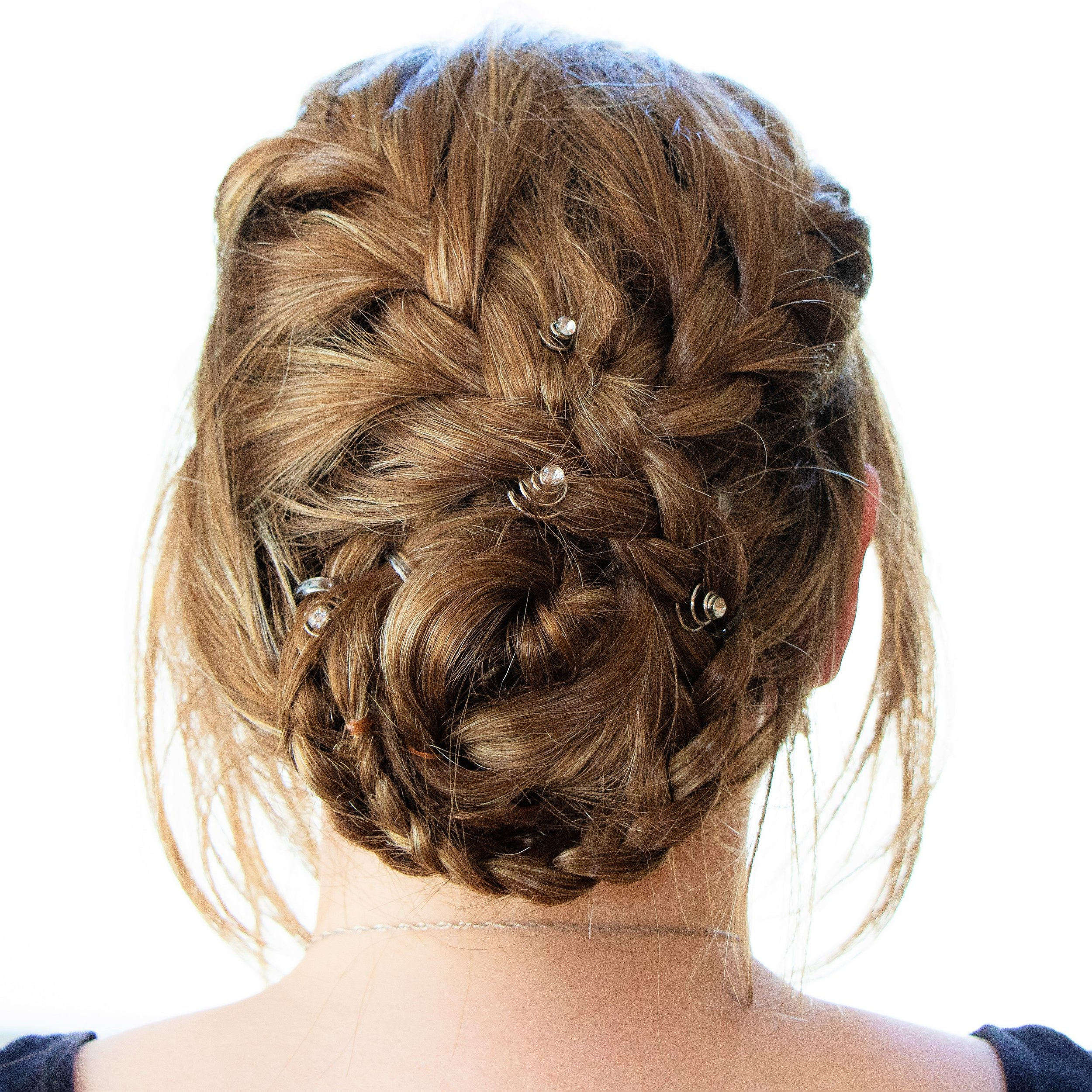 Back view of a beautiful updo bridal style. One of many services offered.