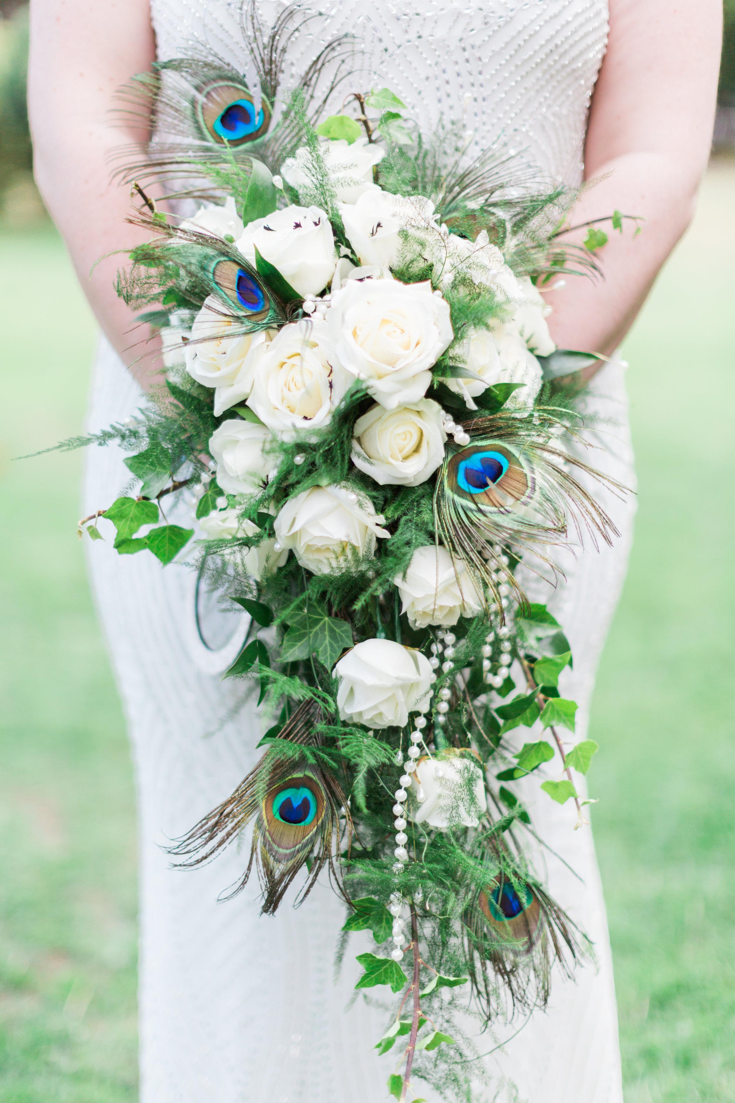 beautiful peacock feathers bouquet.jpg