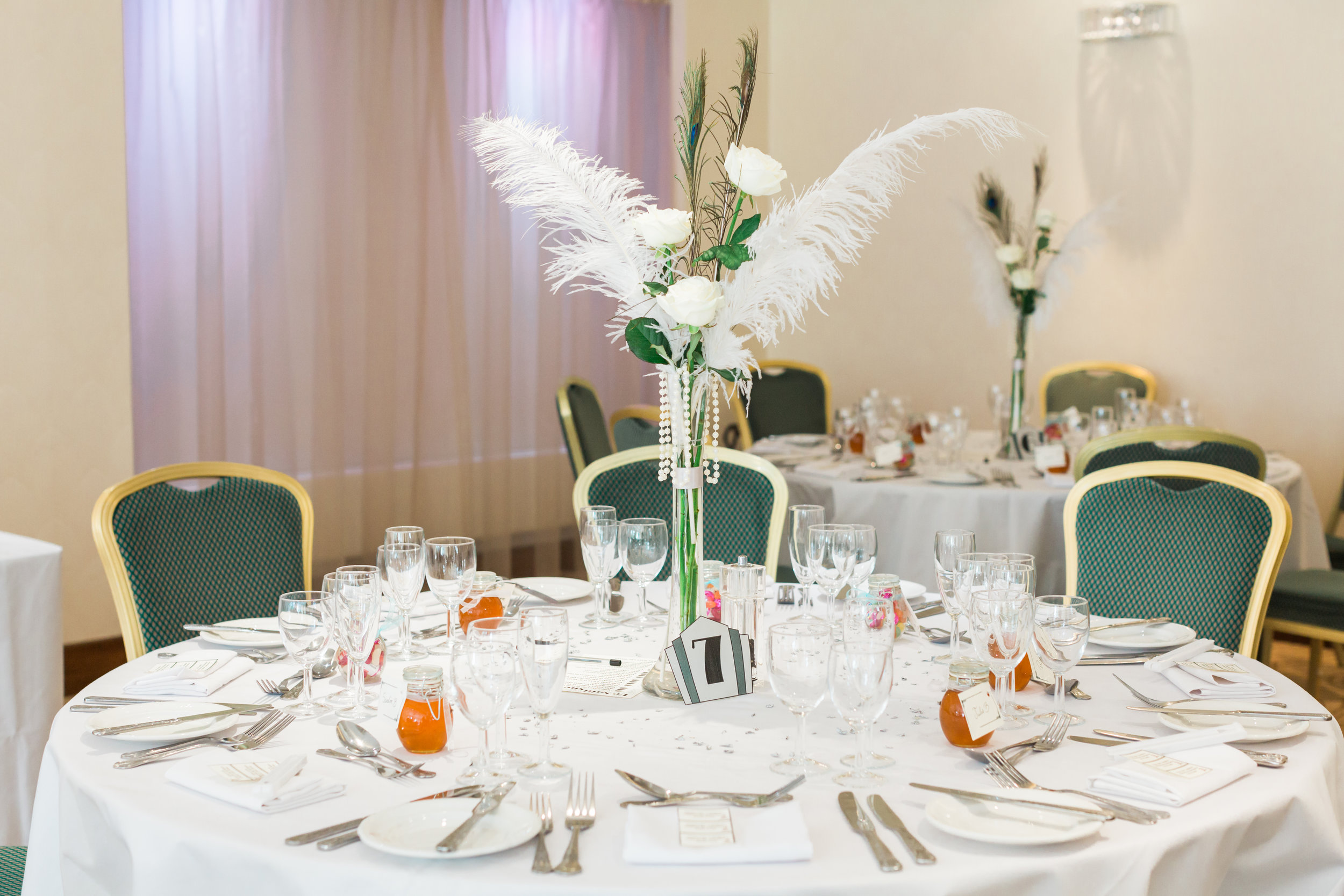 feathers at 1920's wedding.jpg