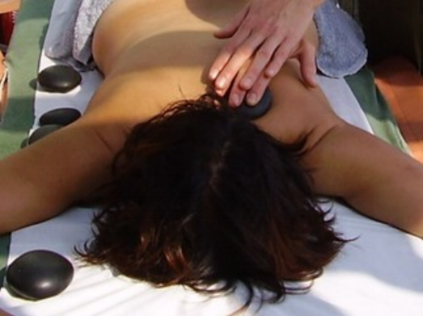 Sarah Holloway is a Hot Stones massage therapist at The Open Door Clinic in Lewes