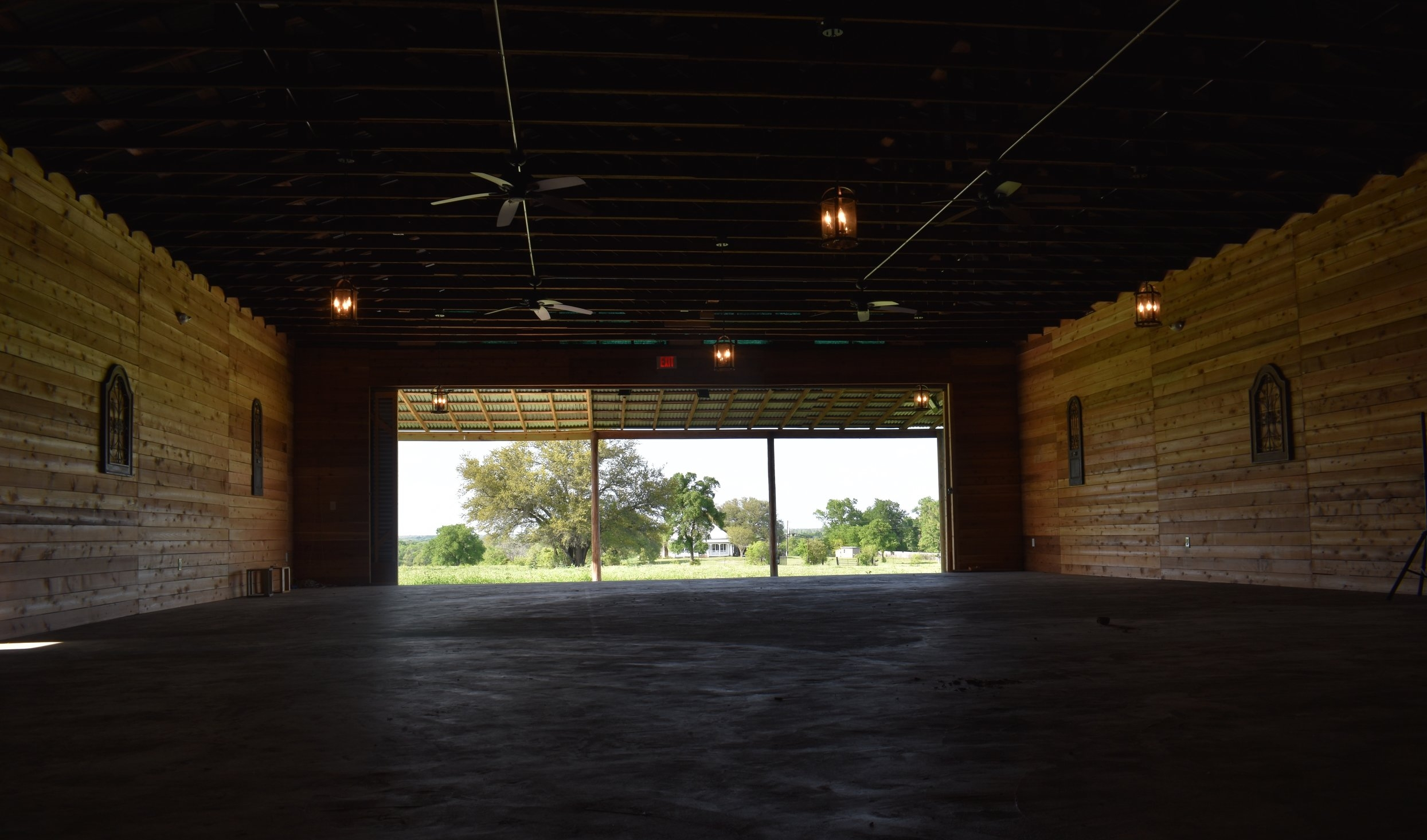 Ceremony Barn with Sliding Doors Fully Open. Provides Beautiful View of House.