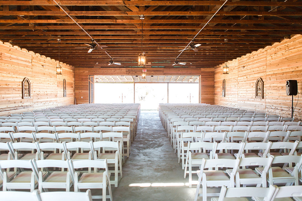 Barn Interior with Chairs Arranged for Ceremony.