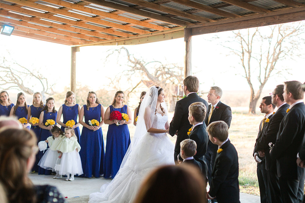 Wedding under Covered Patio with Sliding Doors Fully Open.