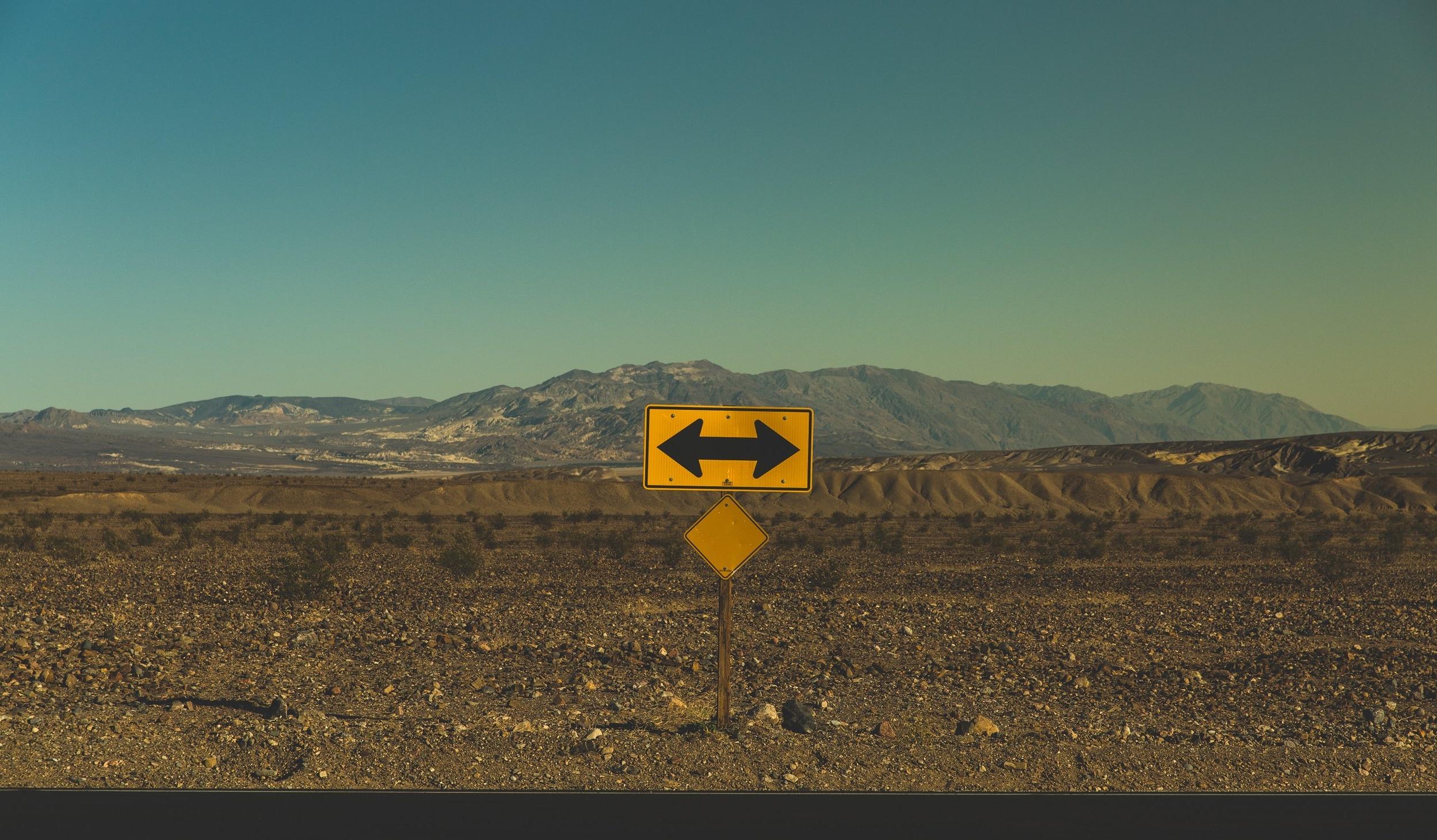 relationship doubts arrow road sign.jpg