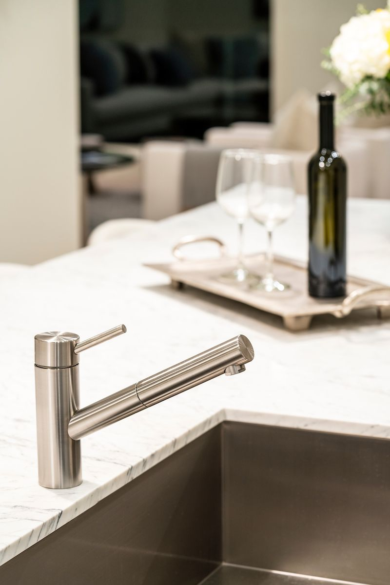 Luxurious modern fixtures throughout. The kitchen has two sinks, each featuring the KWC Swiss Water Experience Suprimo faucet.