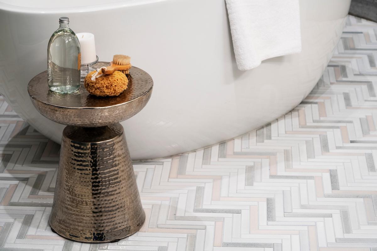 Waterworks luxury fixtures and Waterworks ceramic tile flooring in the bathrooms.