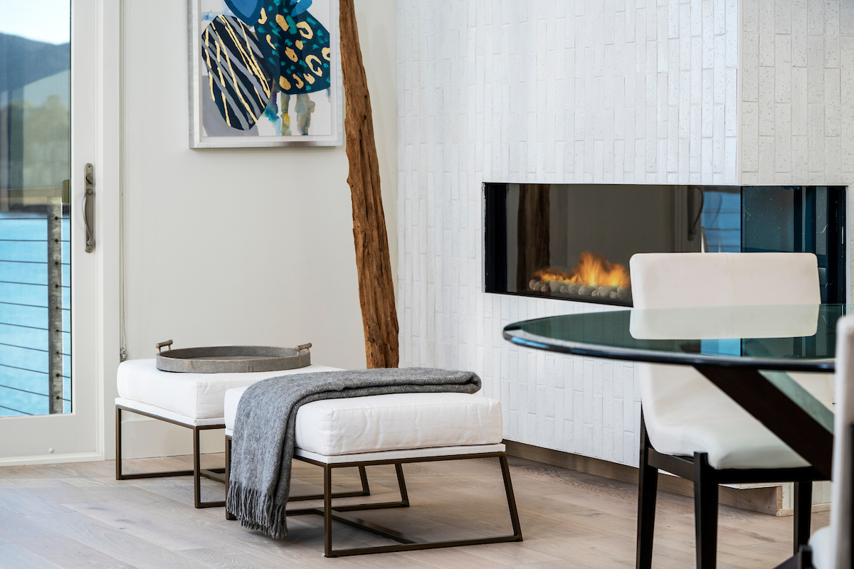 A gas burning fireplace (one of two in the residence) is located in the living room and dining area.