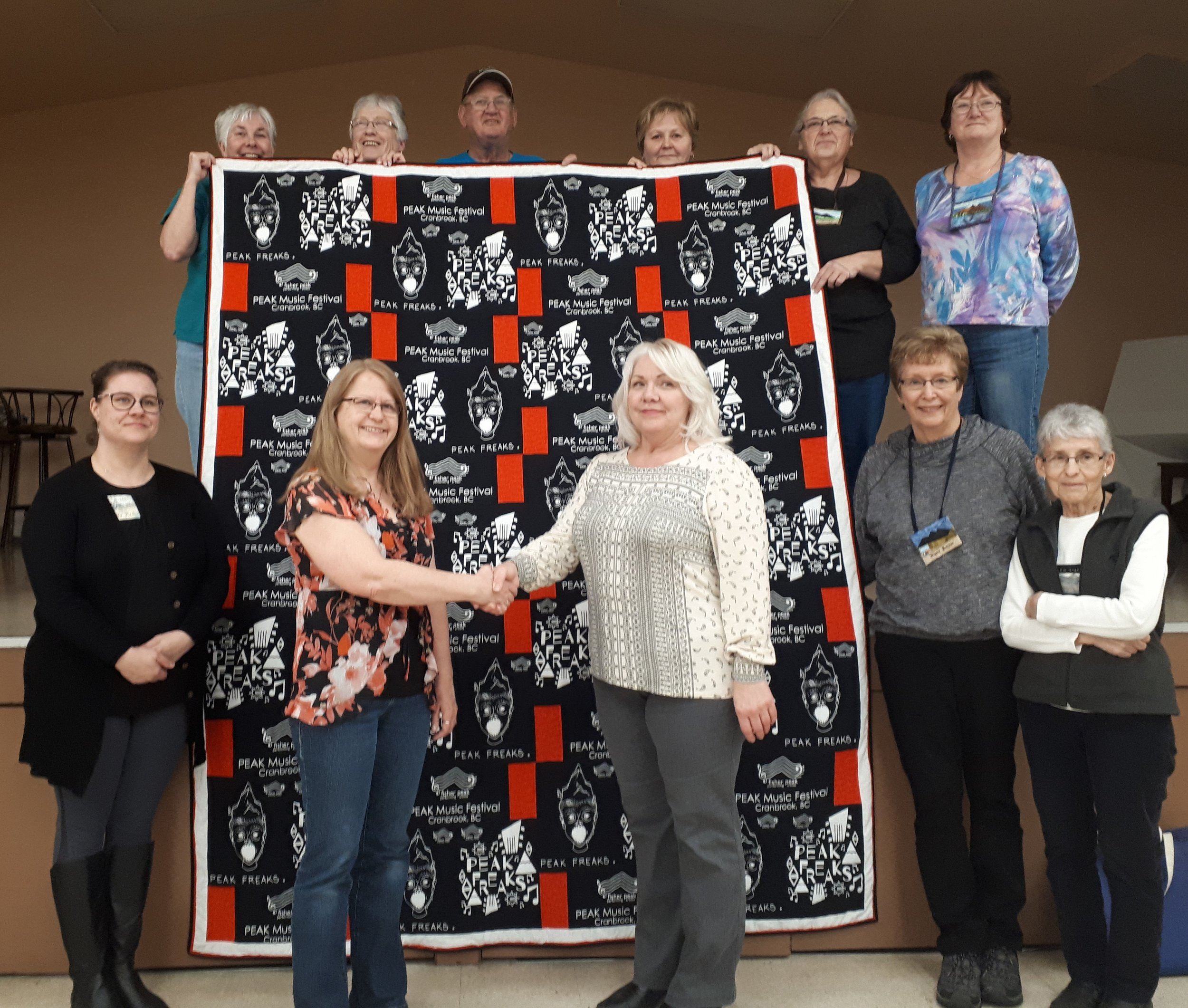 On January 8, 2019 Cranbrook Quilter's Guild ladies present custom quilt to FPPAS Directors Maureen Frank (centre right) and Howie Mason (top centre).