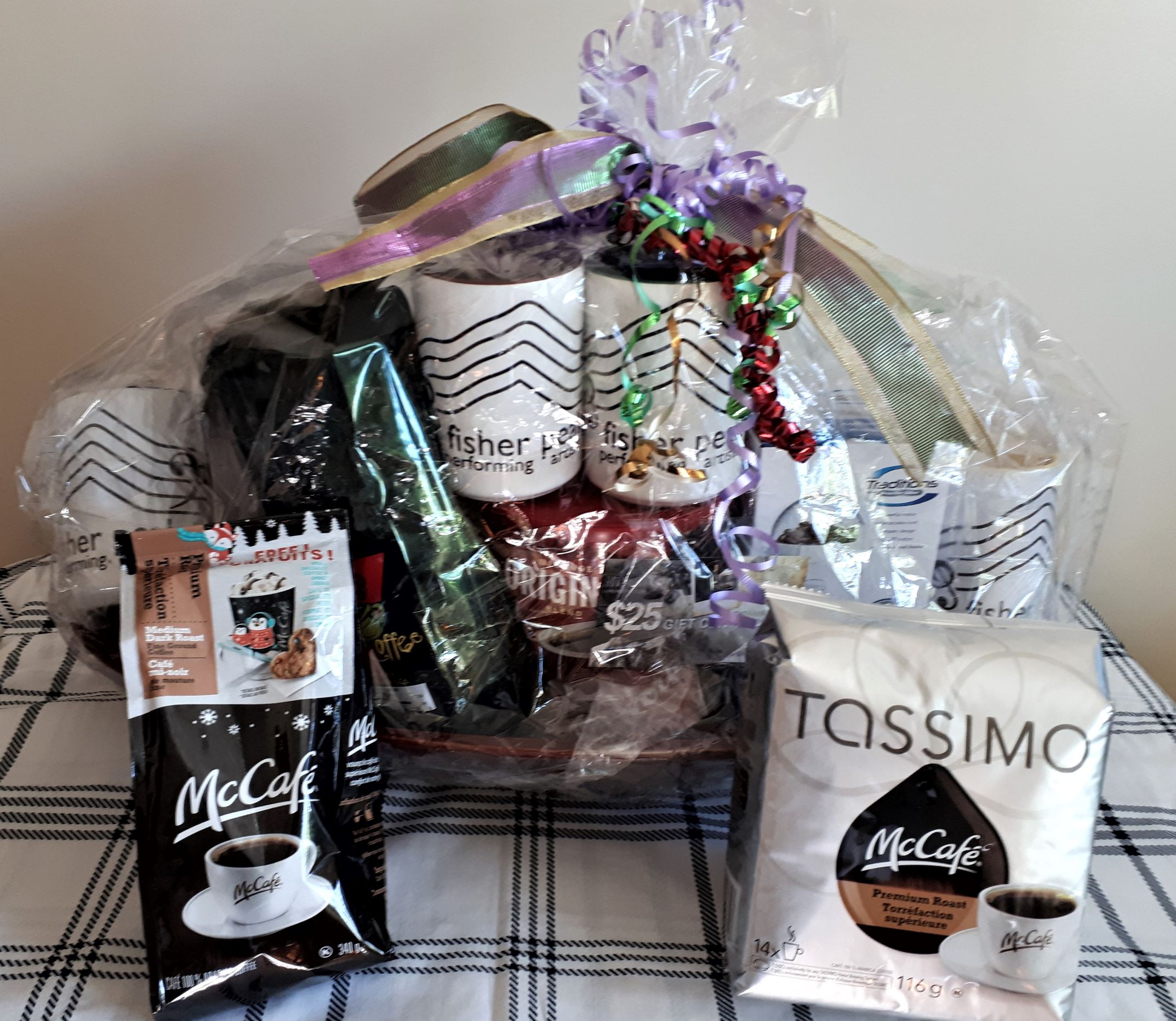 2nd Prize contains: 4 custom mugs from Cranbrook Photo, Coffee from Tim Hortons and Kootenay Roasting Company, coffee grinder and press from Canadian Tire, 25$ Gift Certificate from Hot Shots, coffee + coffee pods + coffee coupons from McDonalds.