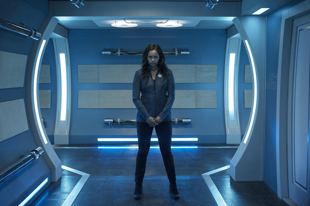 Frankie Adams as Bobbie Draper, from  The Expanse . Draper is a Martian soldier, and she is shown here in a location that serves as the show's shorthand for opulence.