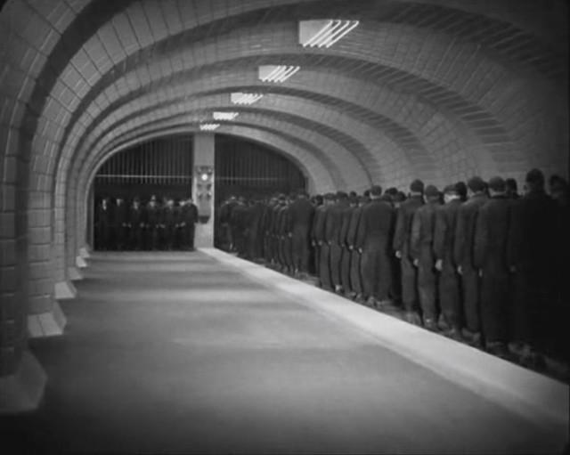 Trudging to work. From  Metropolis  (1927), dir. Fritz Lang.