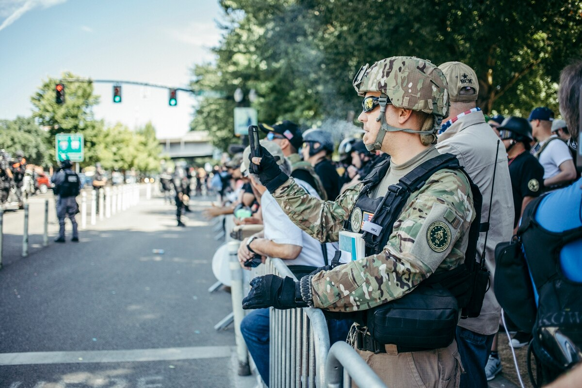 Photo from  Willamette Week , depicting a Three Percenter vaping at a rally in Portland.  While the current situation in Oregon almost went much worse, it is possible that the situation in that state is a suggestion of things to come.